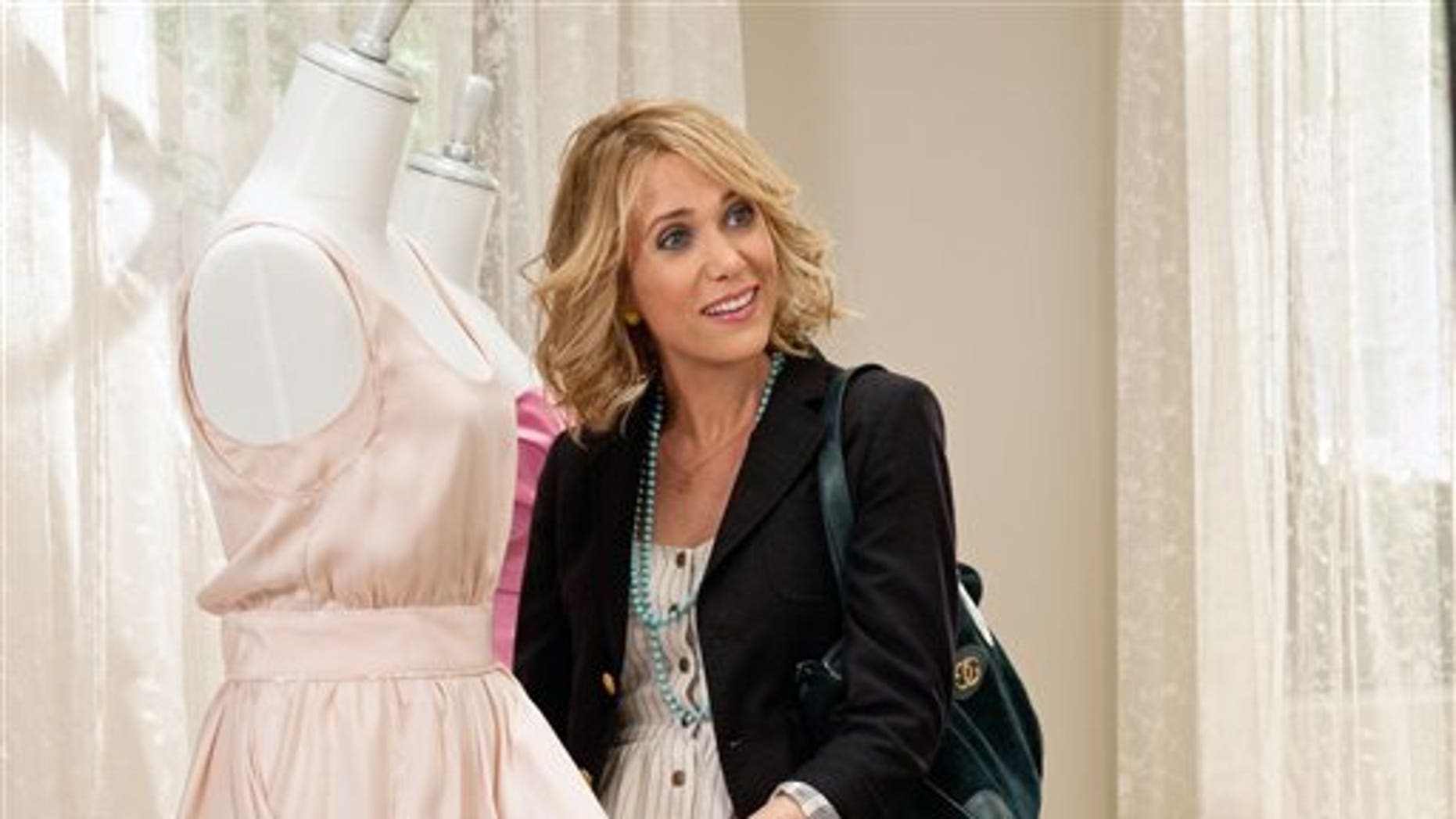"In this publicity image released by Universal Pictures, Kristen Wiig is shown in a scene from ""Bridesmaids."" (AP Photo/Universal Pictures, Suzanne Hanover)"