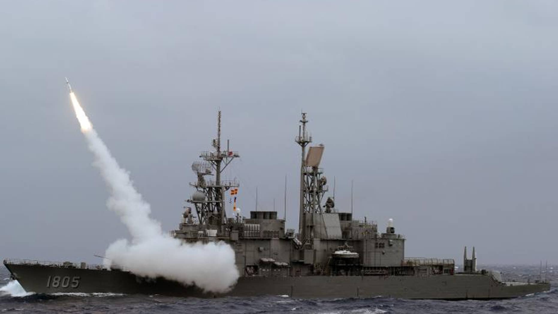 A Taiwan navy Kidd-class destoryer launches a SM-2 surface to air missile during a live fire drill at sea near the east coast of Taiwan on September 26, 2013