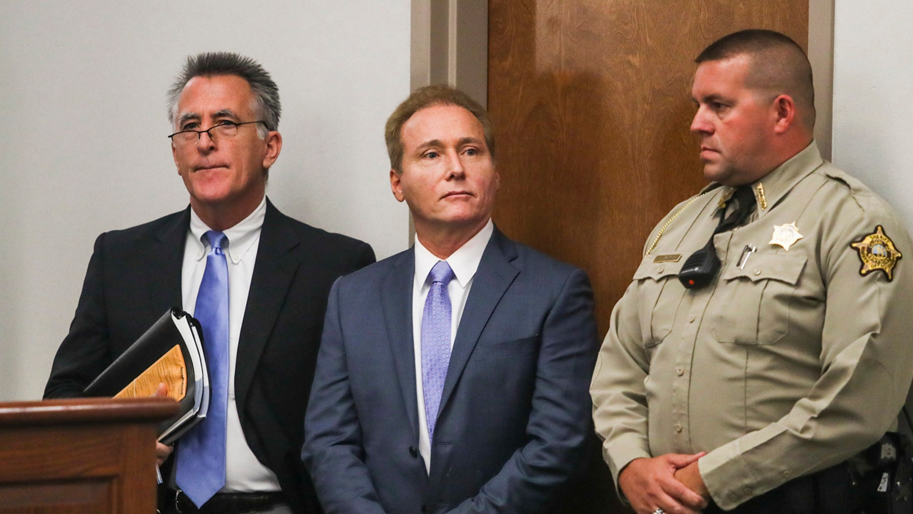 In this Nov. 9 photo, Rene Boucher, center, appears in court for an arraignment hearing with his attorney, Matt Baker, left, at the Warren County Justice Center in Bowling Green, Kentucky.