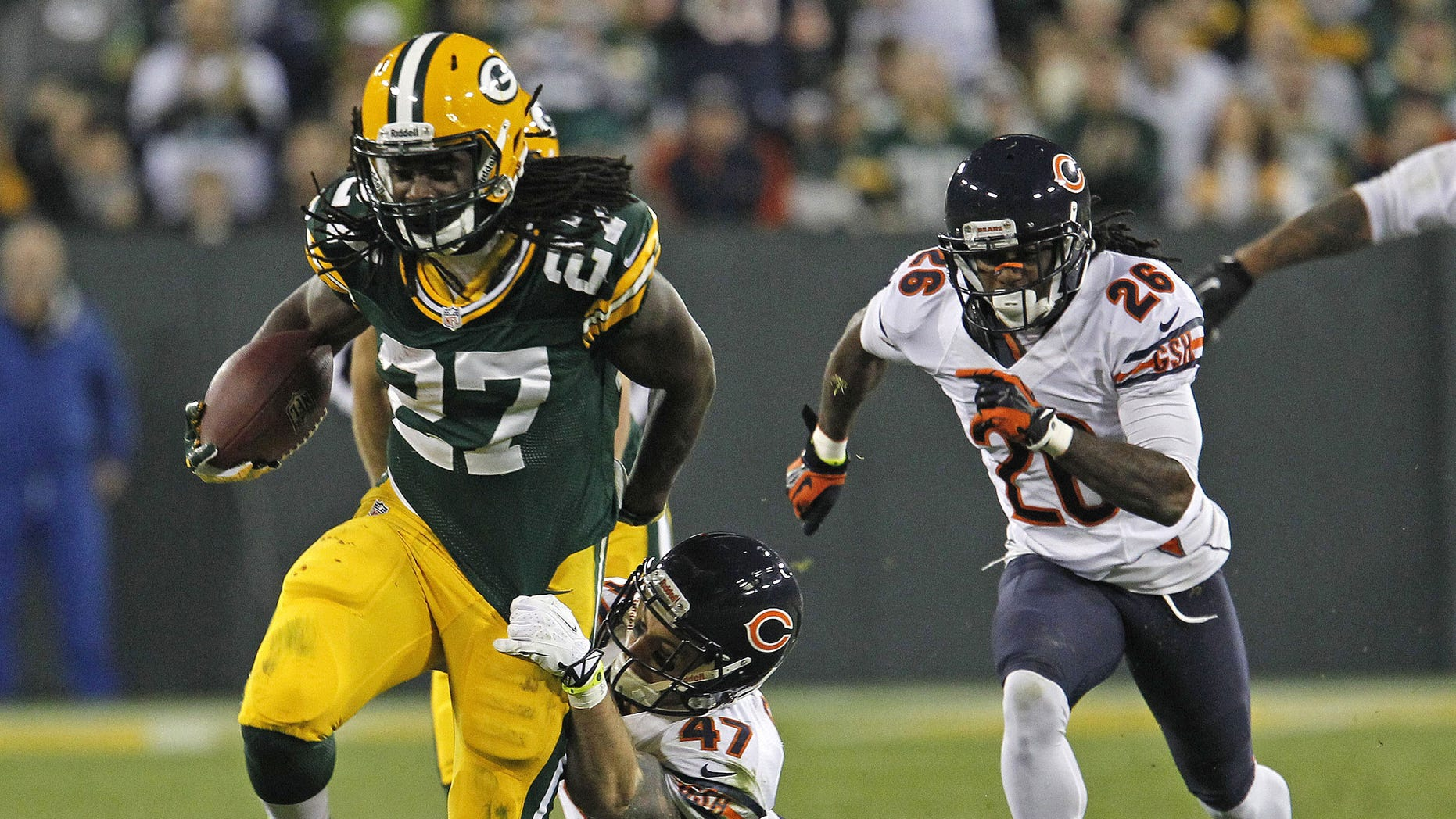 FILE - In this Nov. 4, 2013 file photo, Green Bay Packers running back Eddie Lacy is hit during a run by Chicago Bears free safety Chris Conte during an NFL football game in Green Bay, Wis. The Eagles are counting on seeing a whole lot of Lacy when they play at Green Bay on Sunday, Nov. 10, 2013. The Packers figure to give the ball to their rookie back even more now that Aaron Rodgers is out. (AP Photo/Matt Ludtke, File)