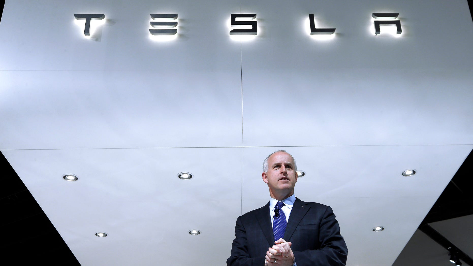 FILE - In this Jan. 14, 2014, photo, Diarmuid O'Connell, Tesla Vice President, Business Development speaks during media previews at the North American International Auto Show in Detroit. Tesla reports quarterly earnings on Wednesday, Feb. 19, 2014. (AP Photo/Paul Sancya, File)
