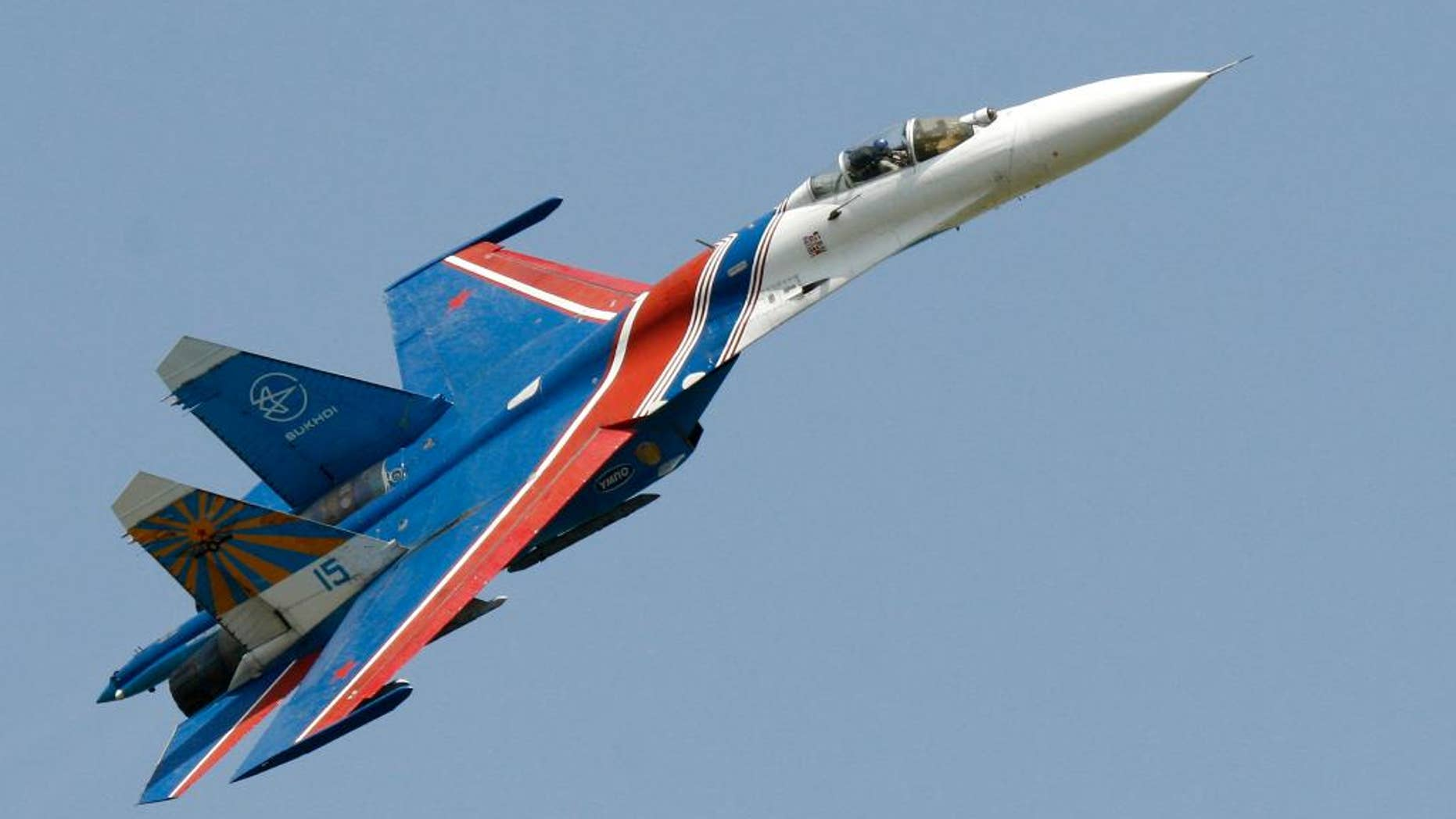 FILE- In this Saturday, May 26, 2007 file photo, a Sukhoi Su-27 fighter jet of the Russian air force elite aerobatic team Russkiye Vityazi (Russian Knights) makes a low pass during an air show in Rostov-on-Don, Russia. A pilot of the Russian air force's elite aerobatic squadron died Thursday, June 9, 2016 when his fighter jet crashed near Moscow. The Russian Defense Ministry said the Su-27 fighter jet went down while returning from a training mission. It said, according to preliminary information, the crash had been caused by a technical malfunction, but wouldn't elaborate pending an official probe. 3 (AP Photo/Sergei Venyavsky, file)