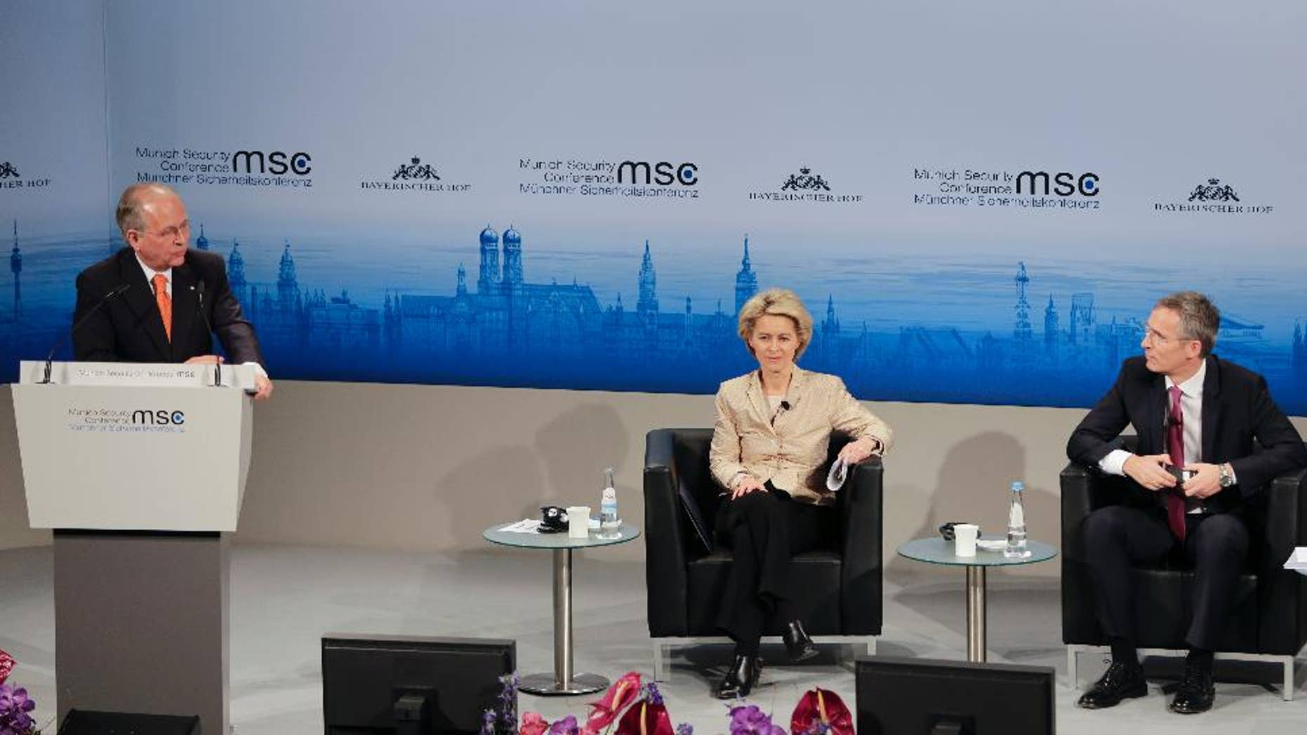 Munich Security Conference Chairman Wolfgang Ischinger, left, welcomes German Defense Minister Ursula von der Leyen, center,  and NATO Secretary General Jens Stoltenberg during his opening speech at the 51. Security Conference in Munich, Germany, Friday, Feb. 6, 2015. The conference on security policy takes place from Feb. 6, 2015  to Feb. 8, 2015. (AP Photo/Matthias Schrader)