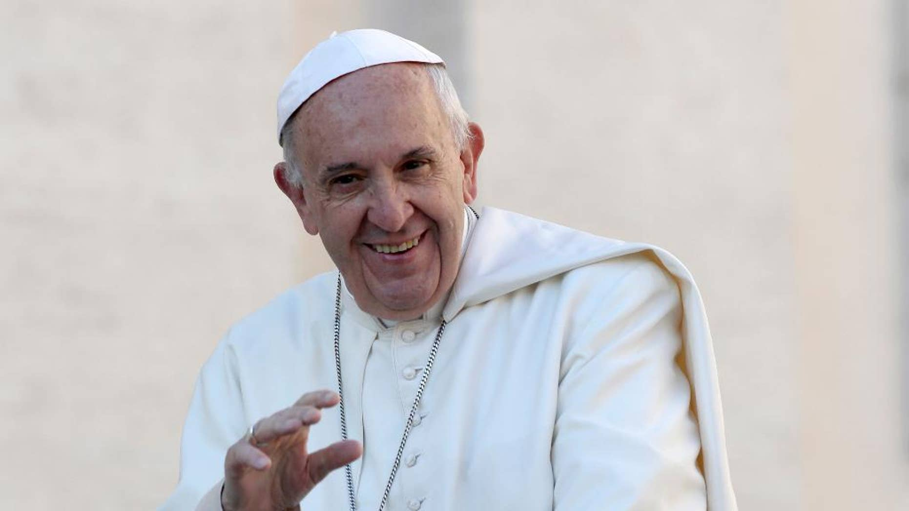 FILE - In this Oct. 19, 2016, file photo, Pope Francis waves to the crowd as he is driven around St. Peter's Square ahead of his weekly general audience, at the Vatican. Francis was presented by Chicago Archbishop Blase Cupich with a Chicago Cubs hat and what looks like a signed baseball at the Vatican Tuesday, Nov. 15, 2016, nearly two weeks after the Cubs won their first World Series since 1908. (AP Photo/Alessandra Tarantino, File)