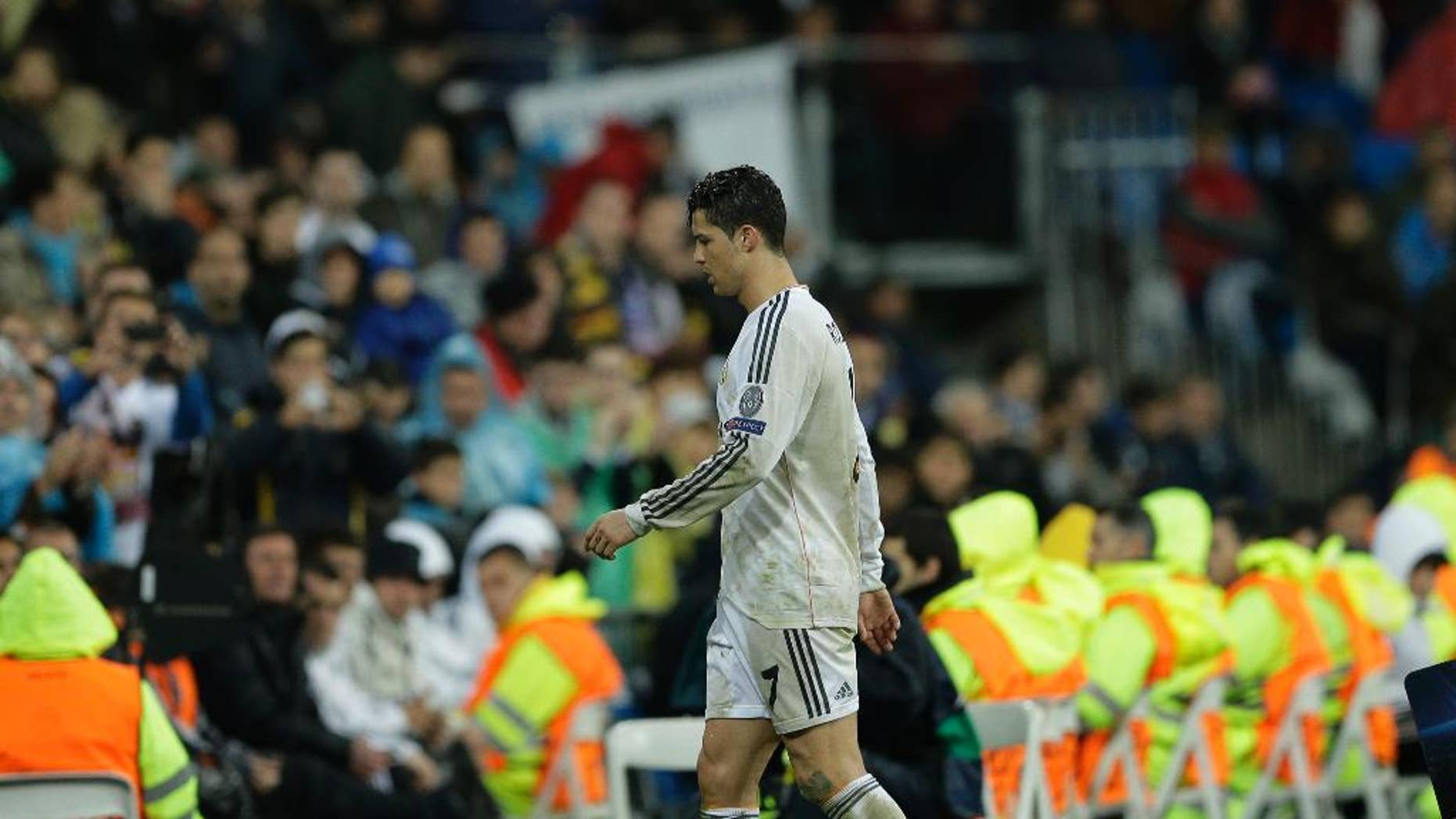 Real's Cristiano Ronaldo leaves the game during a Champions League quarterfinal first leg soccer match between Real Madrid and Borussia Dortmund at the Santiago Bernabeu   stadium in Madrid, Spain, Wednesday April 2, 2014. (AP Photo/Paul White)