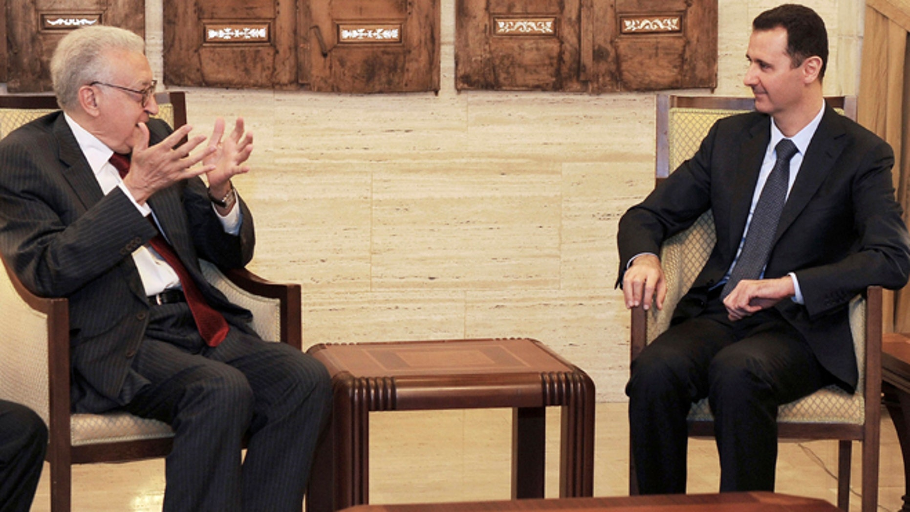 Sept. 15, 2012: In this photo released by the Syrian official news agency SANA, Syrian President Bashar Assad, right, meets with the U.N.-Arab League envoy Lakhdar Brahimi, left, in Damascus, Syria.