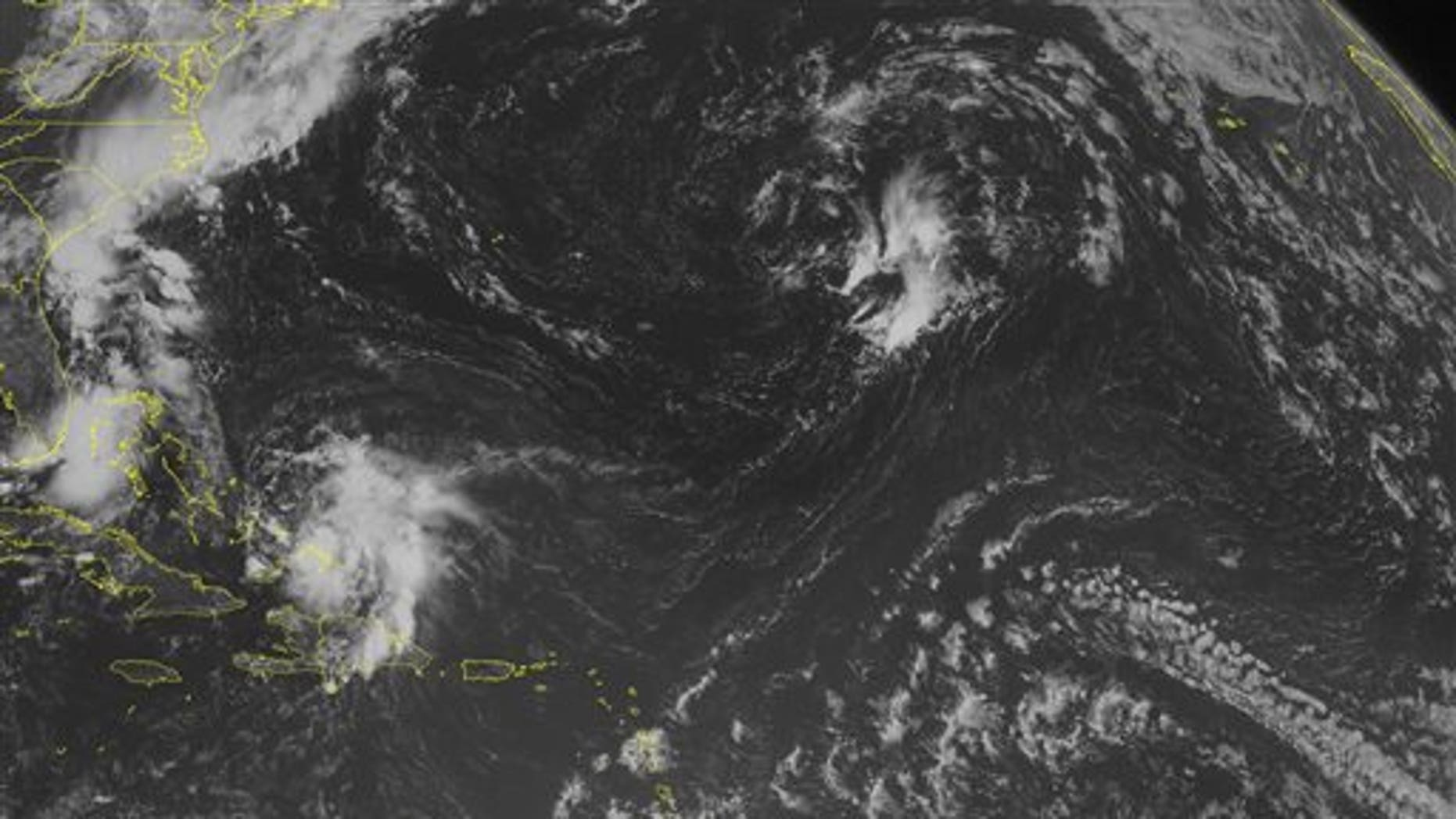 This NOAA satellite image taken Sunday, August 03, 2014 at 10:45 AM EDT shows Tropical Storm Bertha now moving towards the Bahamas. The storm is about 150 miles south of San Salvador. The winds are sustained at 45 MPH and is moving NW at 18 MPH. The central pressure is 1012 is expected remain the sane intensity. (AP PHOTO/WEATHER UNDERGROUND)