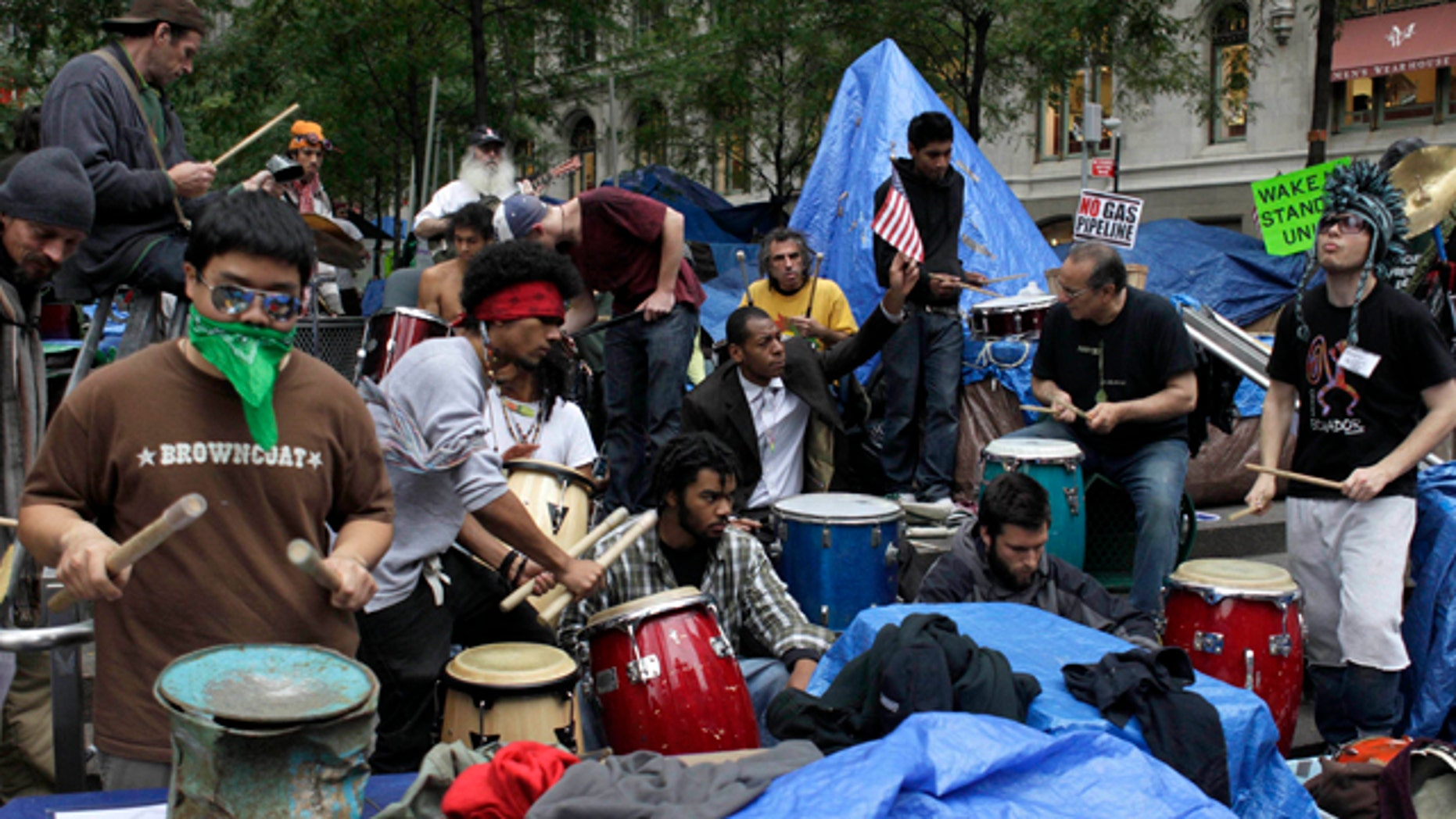 Oct. 26, 2011: Occupy Wall Street protesters play drums and other percussion instruments at Zuccotti Park in New York.