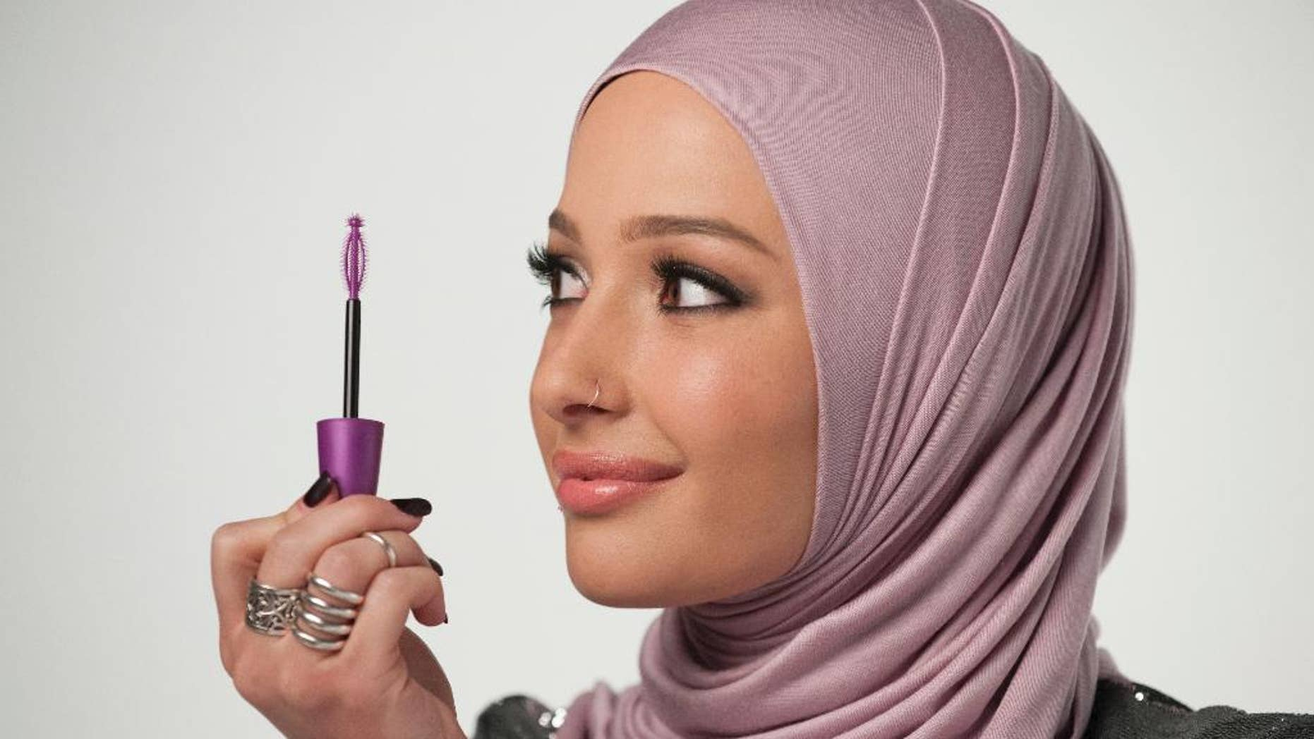 In this undated photo provided by CoverGirl, beauty blogger Nura Afia poses for a photo. CoverGirl is featuring a woman wearing a hijab in its advertising for the first time in the makeup line's history. (Lacey Terrell/CoverGirl via AP)