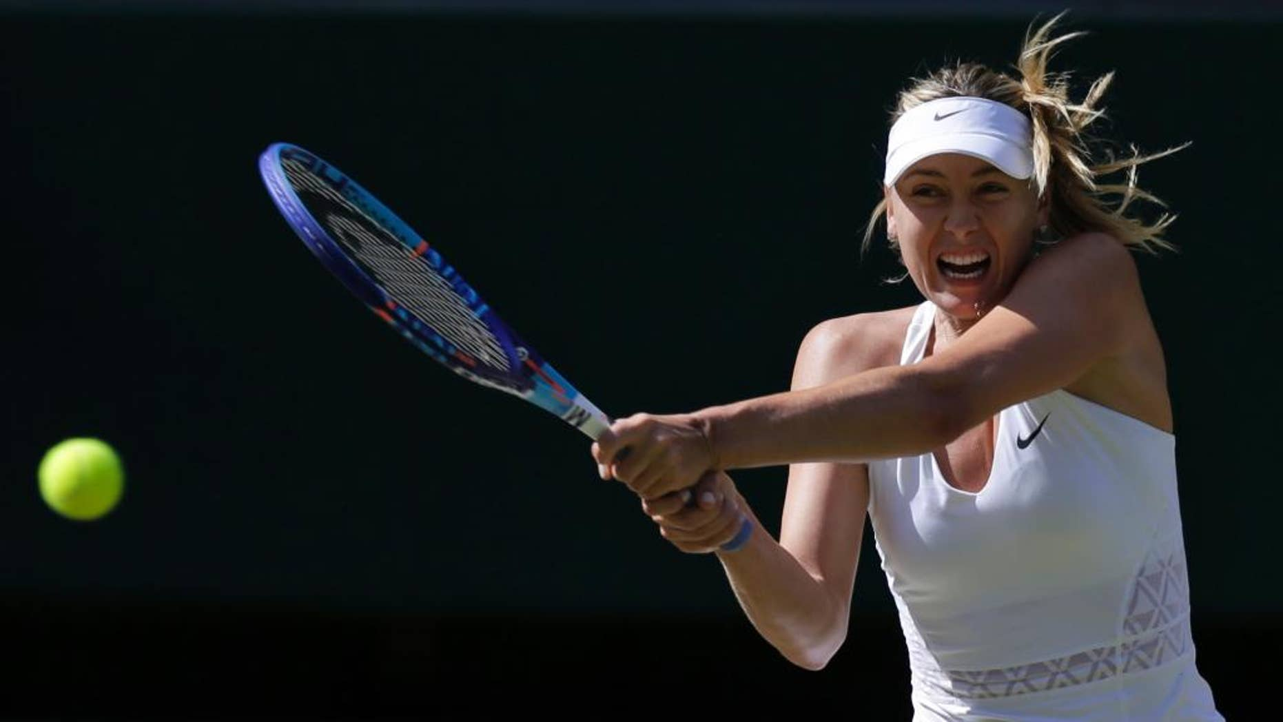 Maria Sharapova of Russia returns a shot to   Serena Williams of the United States, during the women's singles semifinal match at the All England Lawn Tennis Championships in Wimbledon, London, Thursday July 9, 2015. (AP Photo/Pavel Golovkin)