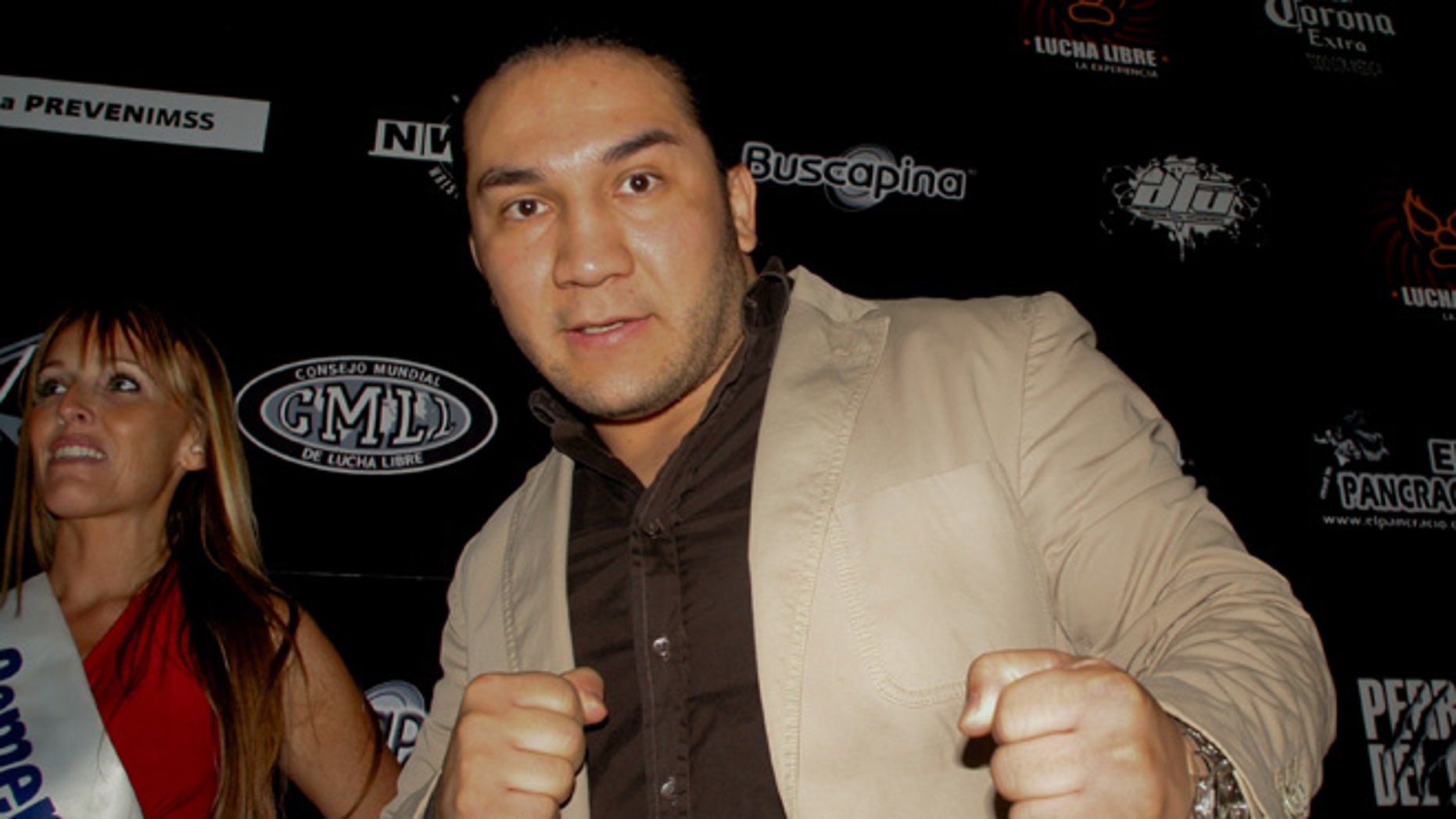In this May 27, 2010 photo, Mexican wrestler Pedro Aguayo Ramirez, known as Hijo del Perro Aguayo, poses for photographers at the start of a news conference in Mexico City. Ramirez, the son of a wrestling legend in the country, died early Saturday March 21, 2015, from a hit suffered in the ring in Tijuana, the Baja California state prosecutor's office said. (AP Photo/Enrique Ordonez-CUARTOSCURO.COM) MEXICO OUT - NO PUBLICAR EN MEXICO - MANDATORY CREDIT - CREDITO OBLIGATORIO