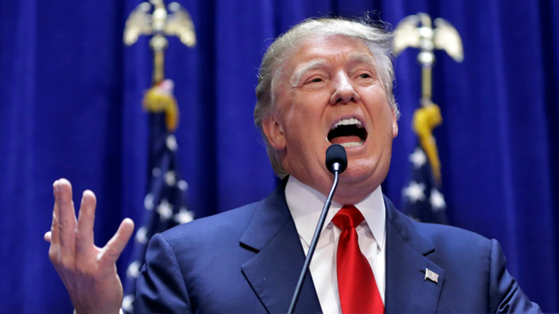 """FILE - This June 16, 2015 file photo shows developer Donald Trump as he delivers remarks during his announcement that he will be a Republican candidate for president, in New York. Univision is dropping the Miss USA pageant and says it will cut all business ties with Donald Trump in a spiraling controversy over comments the Republican presidential hopeful made recently about Mexican immigrants. The company said Thursday, June 25, it would pull the plug on its Spanish-language coverage of the pageant on July 12 by its UniMas network. It also has severed its business relationship with the Miss Universe Organization, which produces the Miss USA pageant, due to what it called """"insulting remarks about Mexican immigrants"""" by Trump, a part owner of the organization. (AP Photo/Richard Drew, File)"""