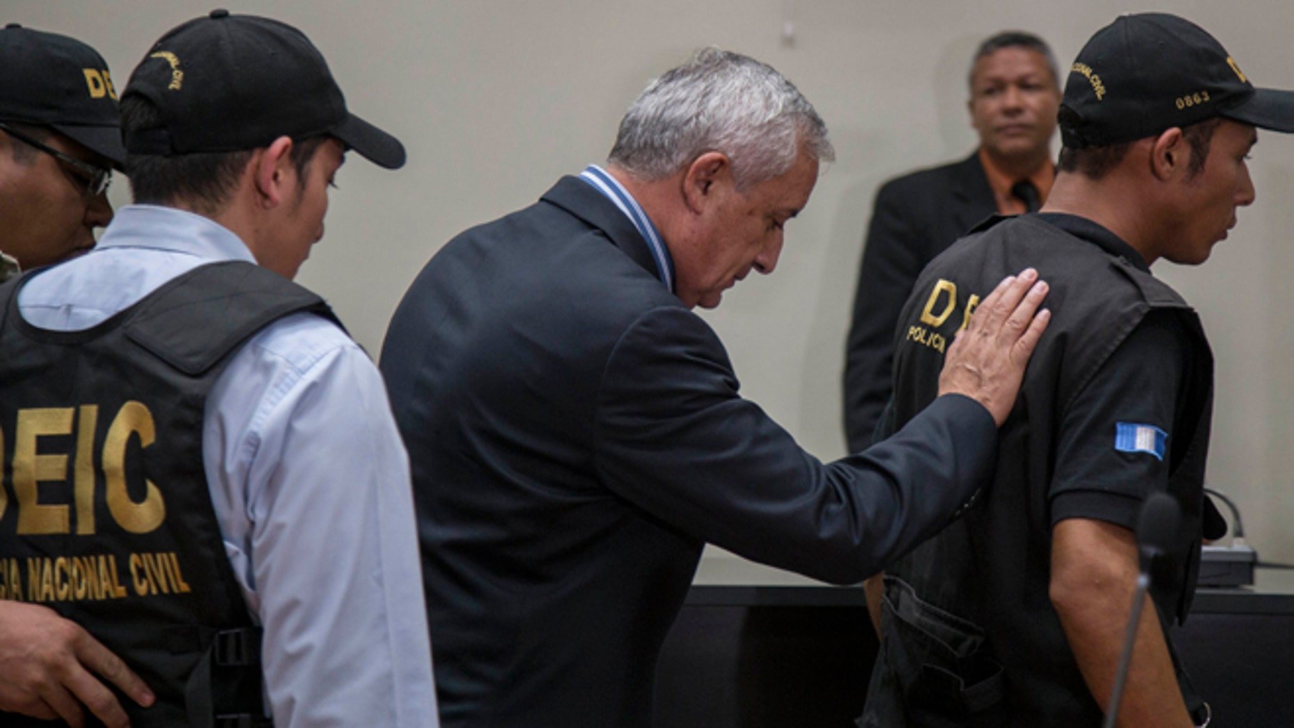 Former President of Guatemala Otto Perez Molina, center, is escorted by police detectives on his way to jail, after a court hearing where he faces corruption charges, in Guatemala City, Thursday, Sept. 3, 2015. Perez Molina was detained overnight before the hearing was to resume Friday morning. Judge Miguel Angel Galvez cited a need to âensure the continuity of the hearingâ and guarantee the former presidentâs personal safety.  (AP Photo/Luis Soto)