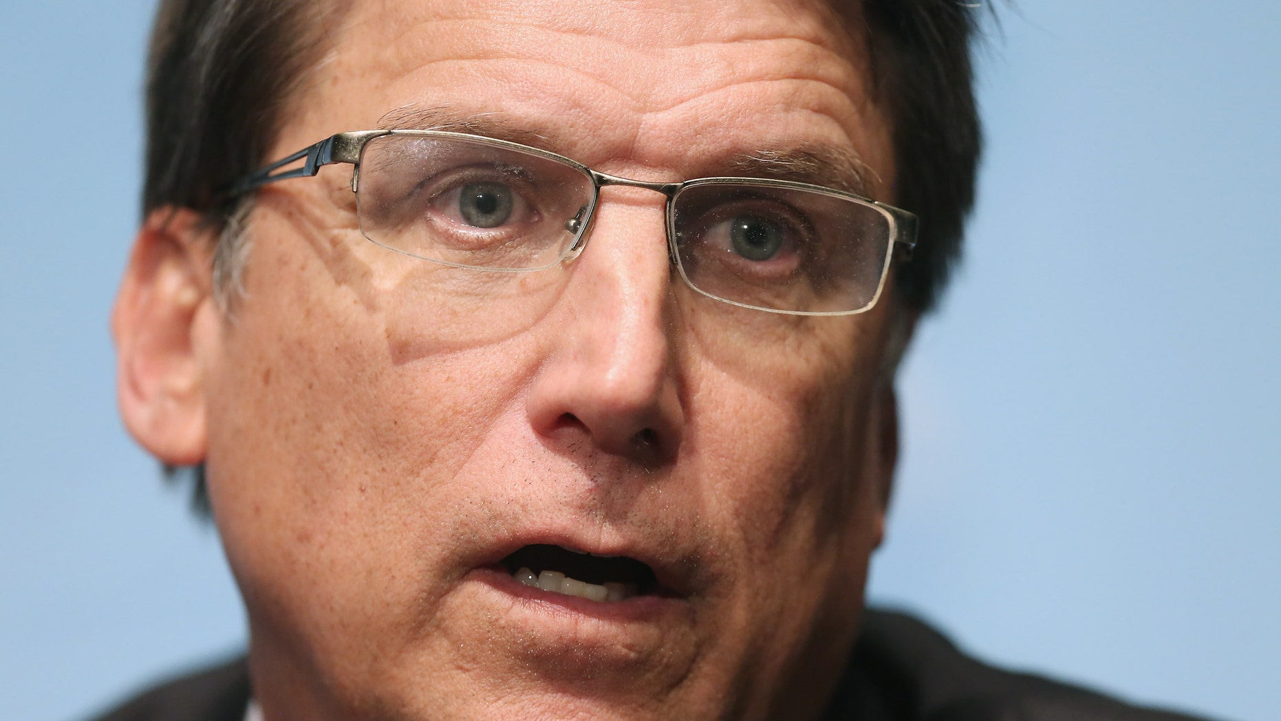 "North Carolina Gov. Pat McCrory said a man who looked like a ""former championship wrestler"" bashed his car with a large tree limb."