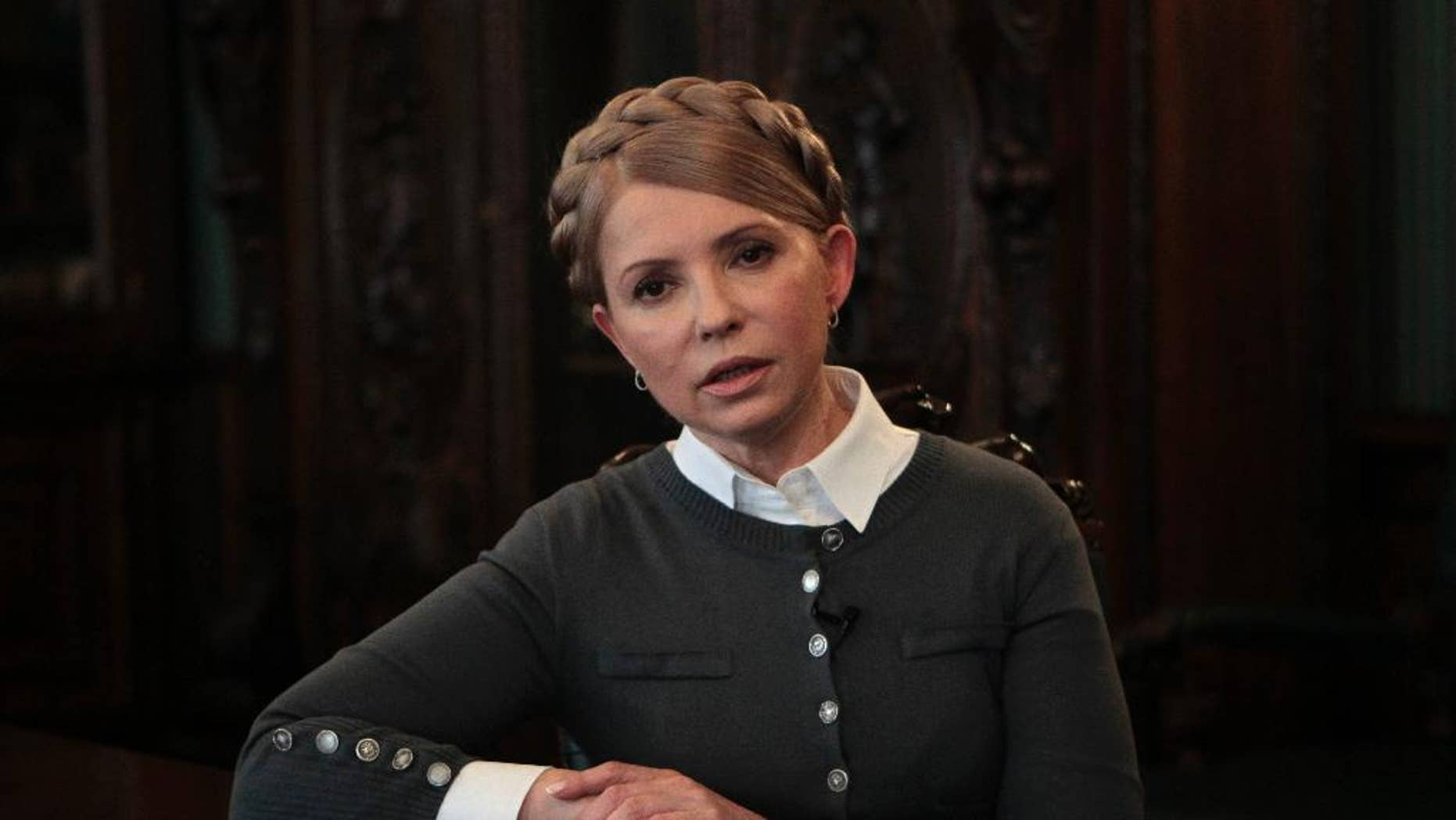 """Former Ukrainian Prime Minister and candidate for the upcoming presidential elections Yulia Tymoshenko speaks during an interview with The Associated Press in Kiev, Ukraine, Saturday, April 26, 2014. Tymoshenko says Ukraine """"must be a member of NATO"""" in order to protect itself from Russian aggression. While Tymoshenko has not previously backed NATO membership publicly, she and other Ukrainian politicians have ramped up the tough rhetoric as pro-Russia militias seized police stations and government buildings across eastern Ukraine. (AP Photo/Sergei Chuzavkov)"""