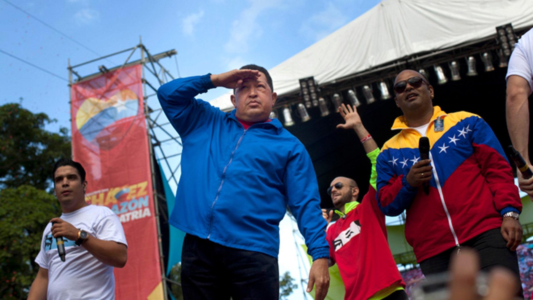 Oct. 3, 2012: Venezuela's President Hugo Chavez, front, gestures during a campaign rally in Maracay, Venezuela.