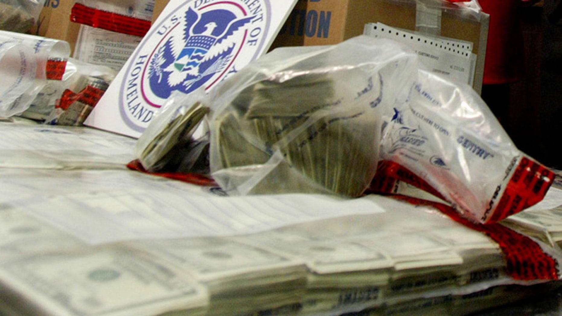 FILE: Nov. 2003: Cash seized in a federal investigation. (Reuters)