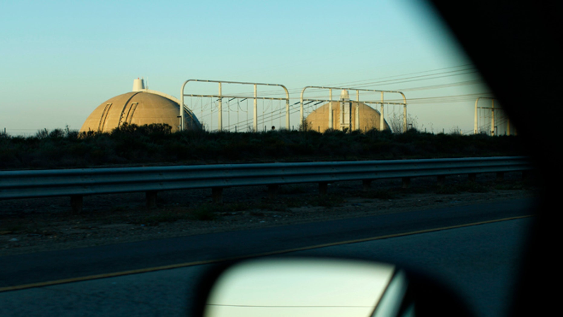 February 23, 2013: The San Onofre Nuclear Generating Station is seen from a car driving along Interstate 5, north of San Diego County near San Clemente, California.