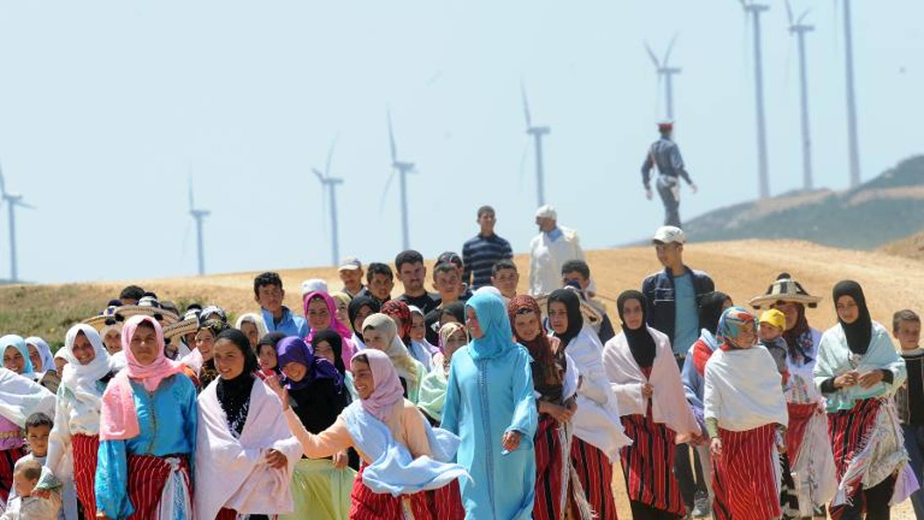 Villagers of Dahr Saadane walk in front of the wind farm on June 28, 2010 in Tangiers.