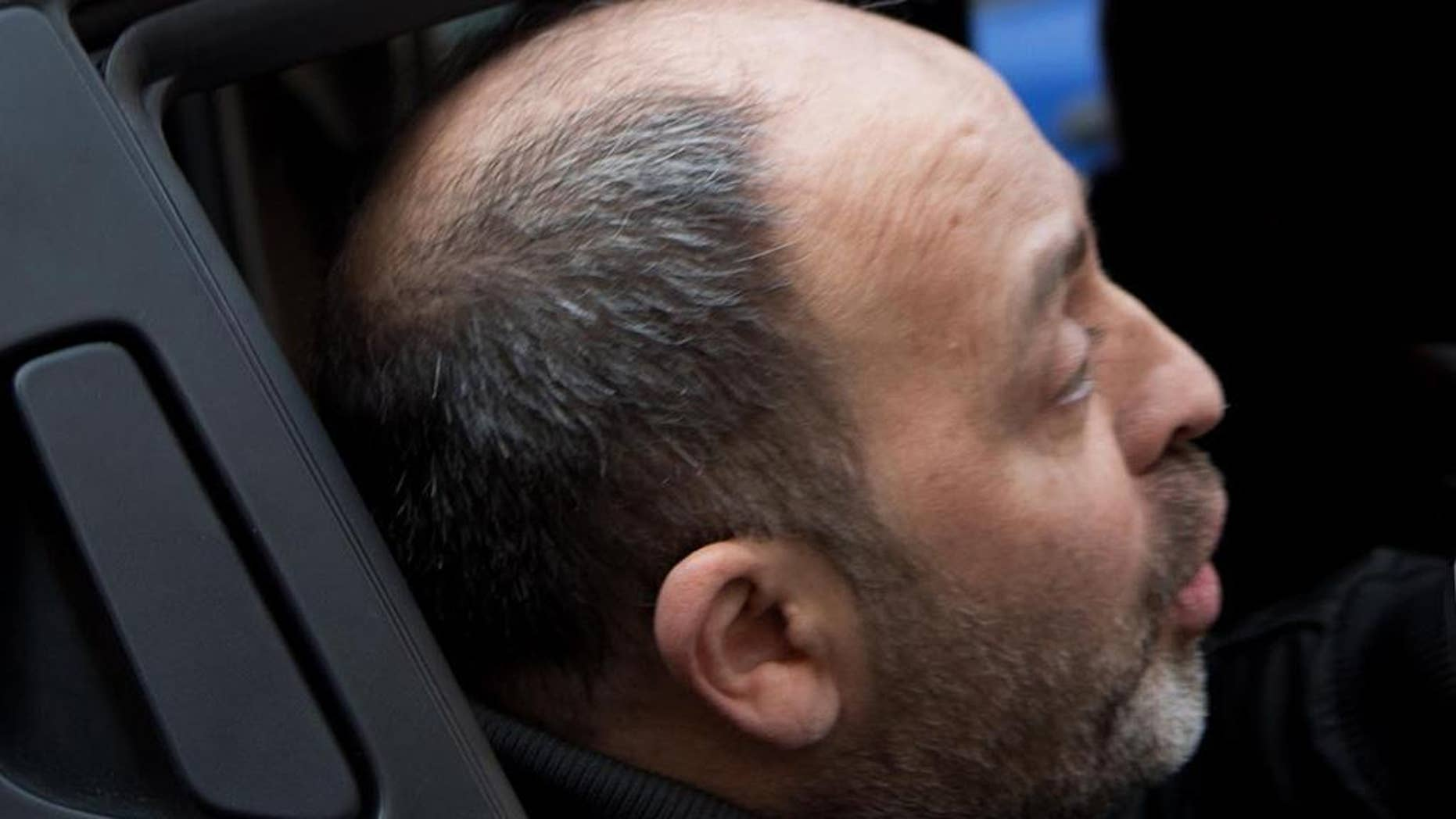 Fugitive mobster Santo Vottari is taken into custody by Italian Carabinieri after they found him hiding in a cramped crawl space behind a trap door of a bunker in an apartment building in the southern Italian town of Ricciolino di Benestare, Wednesday, March 22, 2017.  Vottari, who, according to authorities, is tied to a crime clan involved in a 2007 massacre of 6 Italians in Duisburg, Germany, had been convicted in absentia of mafia-like association. (Marco Costantino/ANSA via AP)