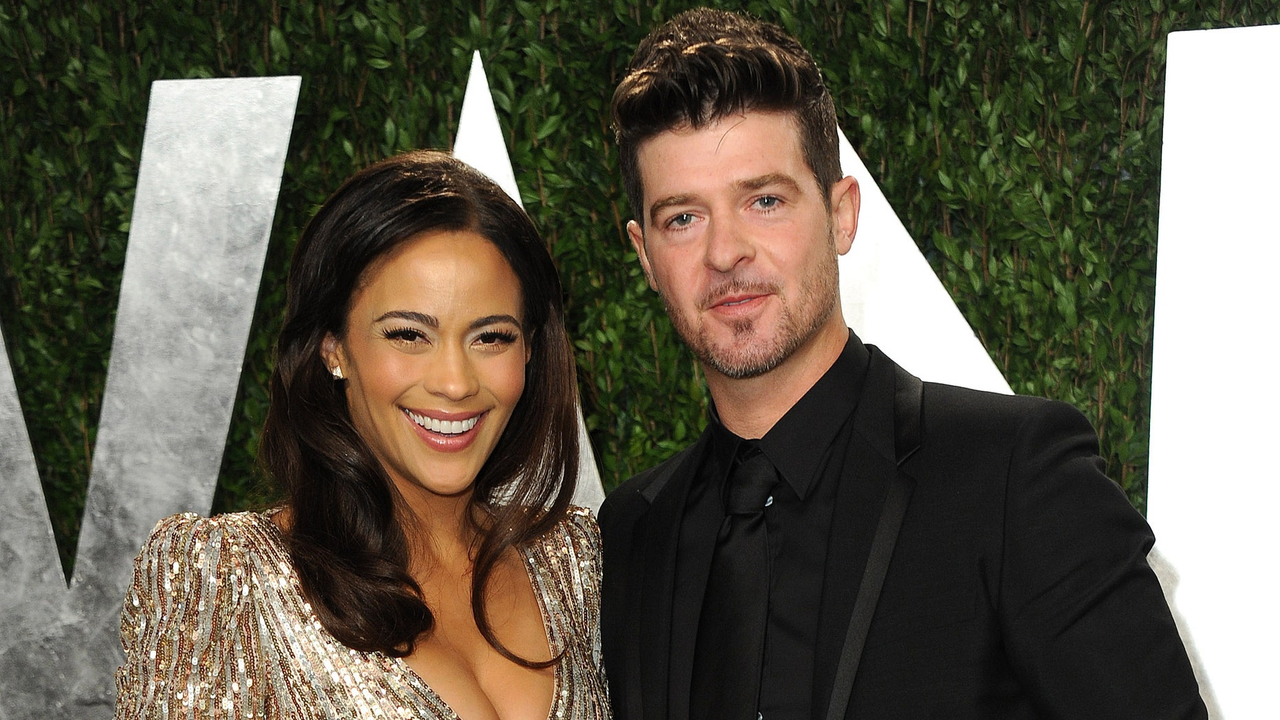 FILE - In this Feb. 24, 2013 file photo, Paula Patton and Robin Thicke arrive at the 2013 Vanity Fair Oscars Viewing and After Party at the Sunset Plaza Hotel in West Hollywood, Calif. Thicke is thanking his fans for their support following his separation from his wife and canceled tour dates. Thicke and actress Paula Patton announced Monday they are separating after being married for nine years. They have a three-year-old son, and Patton was the inspiration behind much of Thicke's music and appeared in some of his music videos. (Photo by Jordan Strauss/Invision/AP, File)