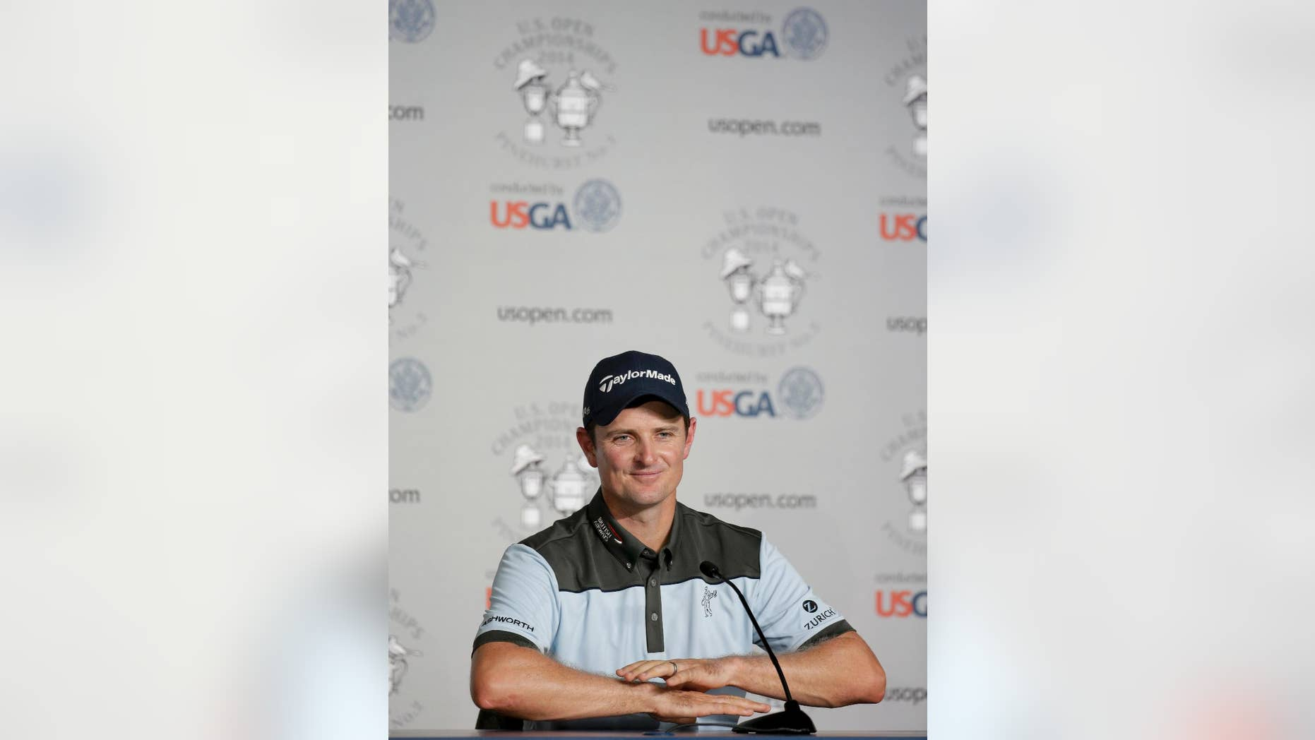 Justin Rose, of England, talks during a news conference for the U.S. Open golf tournament in Pinehurst, N.C., Tuesday, June 10, 2014. The tournament starts Thursday. (AP Photo/Eric Gay)