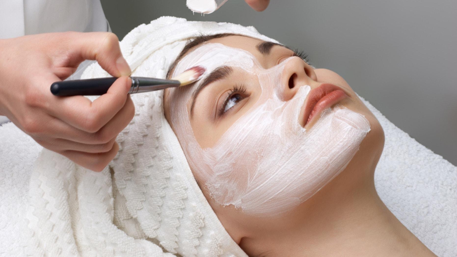 beauty salon series. facial mask applying