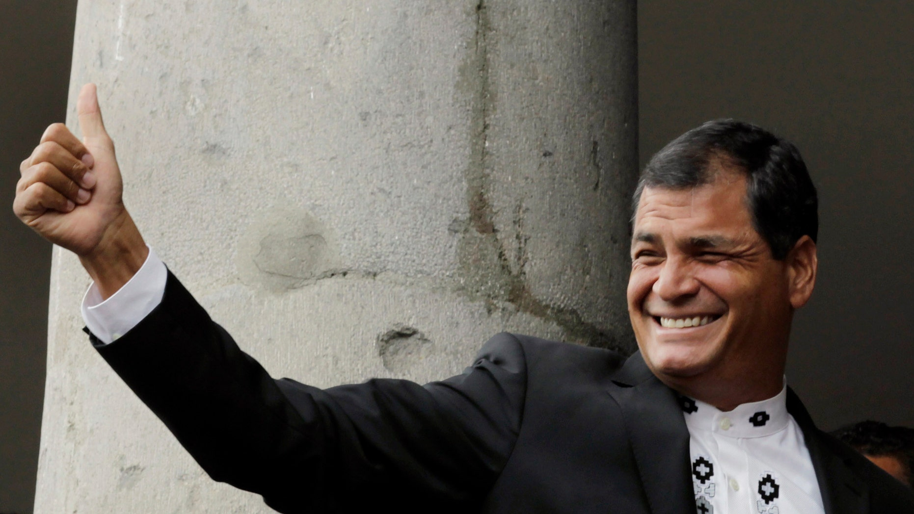 FILE - In this Feb. 16, 2013 file photo, Ecuador's President Rafael Correa gives a thumbs up to supporters as he stands with the Emir of Qatar Sheikh Hamad bin Khalifa al-Thani, not in picture, on a balcony at the government palace in Quito, Ecuador.  On Friday, May 24, 2013, Correa will begin his second presidential term after winning the Feb. 17 election.  (AP Photo/Dolores Ochoa, File)