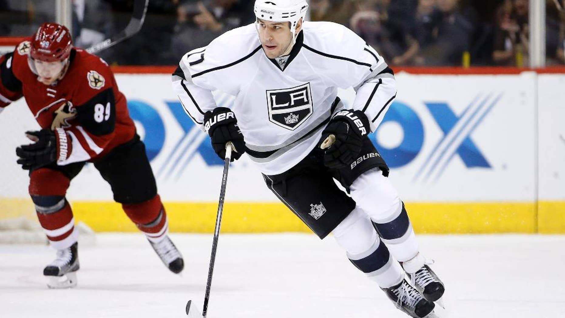 FILE- In this Feb. 2, 2016, file photo, Los Angeles Kings' Milan Lucic (17) skates with the puck during an NHL hockey game in Glendale, Ariz. The New Jersey Devils have acquired former No. 1 overall draft pick Taylor Hall from the Edmonton Oilers for defenseman Adam Larsson, which the teams announced Wednesday, June 29, 2016, two days before the start of free agency. The Oliers get salary cap space to possibly sign free agent Lucic with Hall's $6 million annual salary heading to New Jersey. (AP Photo/Ross D. Franklin. File)