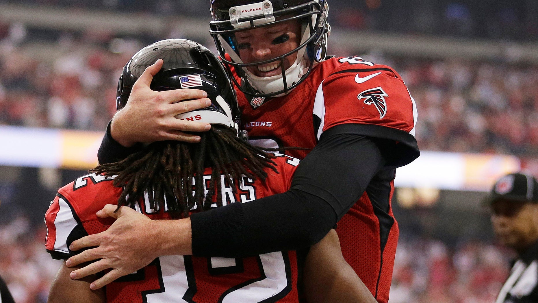 In this photo taken Sunday, Oct. 20, 2013, Atlanta Falcons quarterback Matt Ryan (2) celebrates with Jacquizz Rodgers (32) after Rodgers scored a touchdown against the Tampa Bay Buccaneers in the first half of an NFL football game in Atlanta. Ryan figured out a way to lead the Falcons out of their three-game losing streak despite having no running game and new names at wide receiver. (AP Photo/John Bazemore)