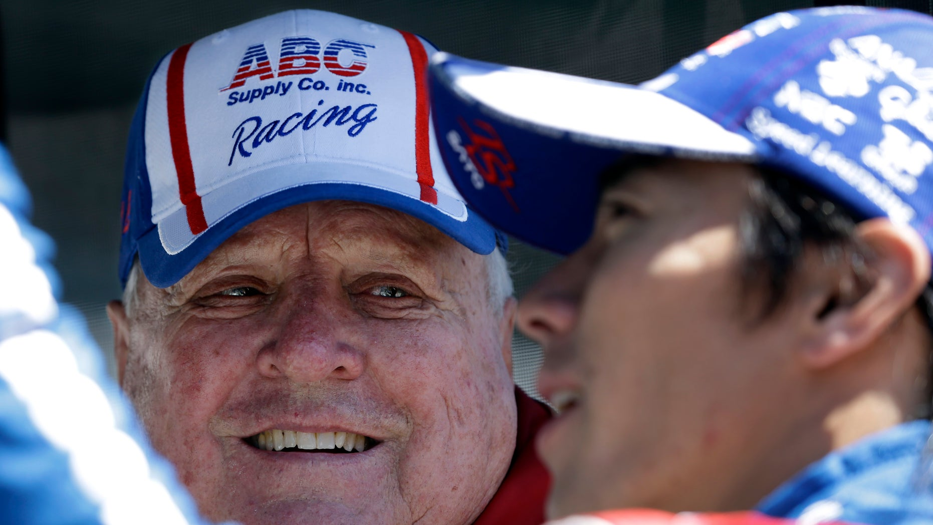 Car owner A.J. Foyt talks with driver Takuma Sato, of Japan, during practice for the Indianapolis 500 auto race at the Indianapolis Motor Speedway in Indianapolis, Monday, May 13, 2013. (AP Photo/Darron Cummings)