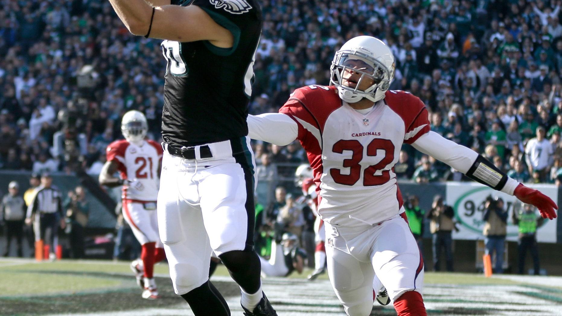 Philadelphia Eagles' Zach Ertz, left, pulls in a touchdown pass as Arizona Cardinals' Tyrann Mathieu defends during the first half of an NFL football game, Sunday, Dec. 1, 2013, in Philadelphia. (AP Photo/Matt Rourke)
