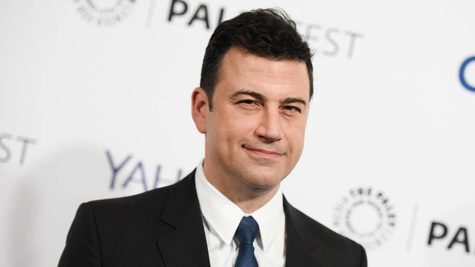 """FILE - In this March 8, 2015, file photo, Jimmy Kimmel arrives at the 32nd Annual Paleyfest : """"Scandal"""" held at The Dolby Theatre in Los Angeles. Kimmel's contract with ABC has been extended through 2019. (Photo by Richard Shotwell/Invision/AP, File)"""