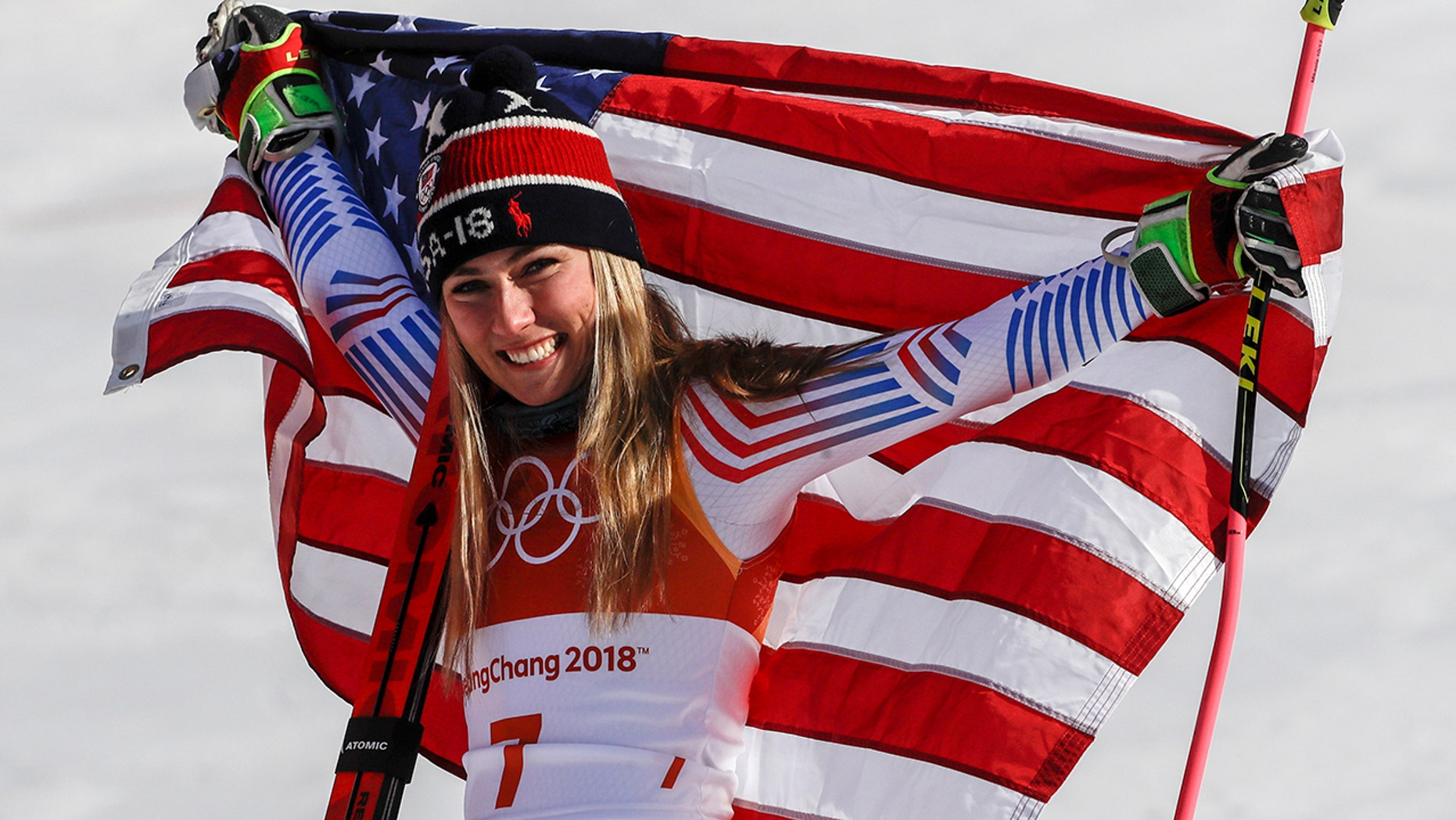 Mikaela Shiffrin celebrates her gold medal after placing first in the women's giant slalom at the 2018 Winter Olympics.