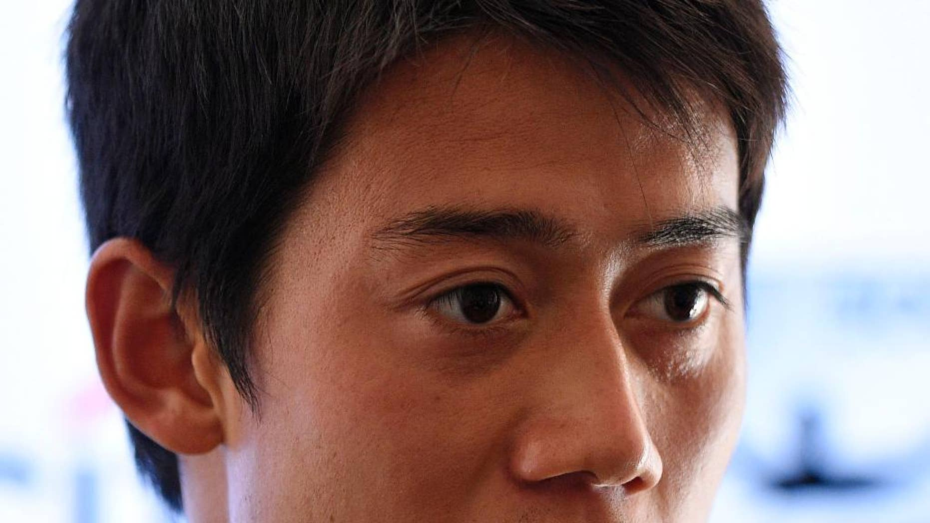 Kei Nishikori, of Japan, speaks at a press conference at the Citi Open tennis tournament, Monday, Aug. 3, 2015, in Washington. (AP Photo/Nick Wass)