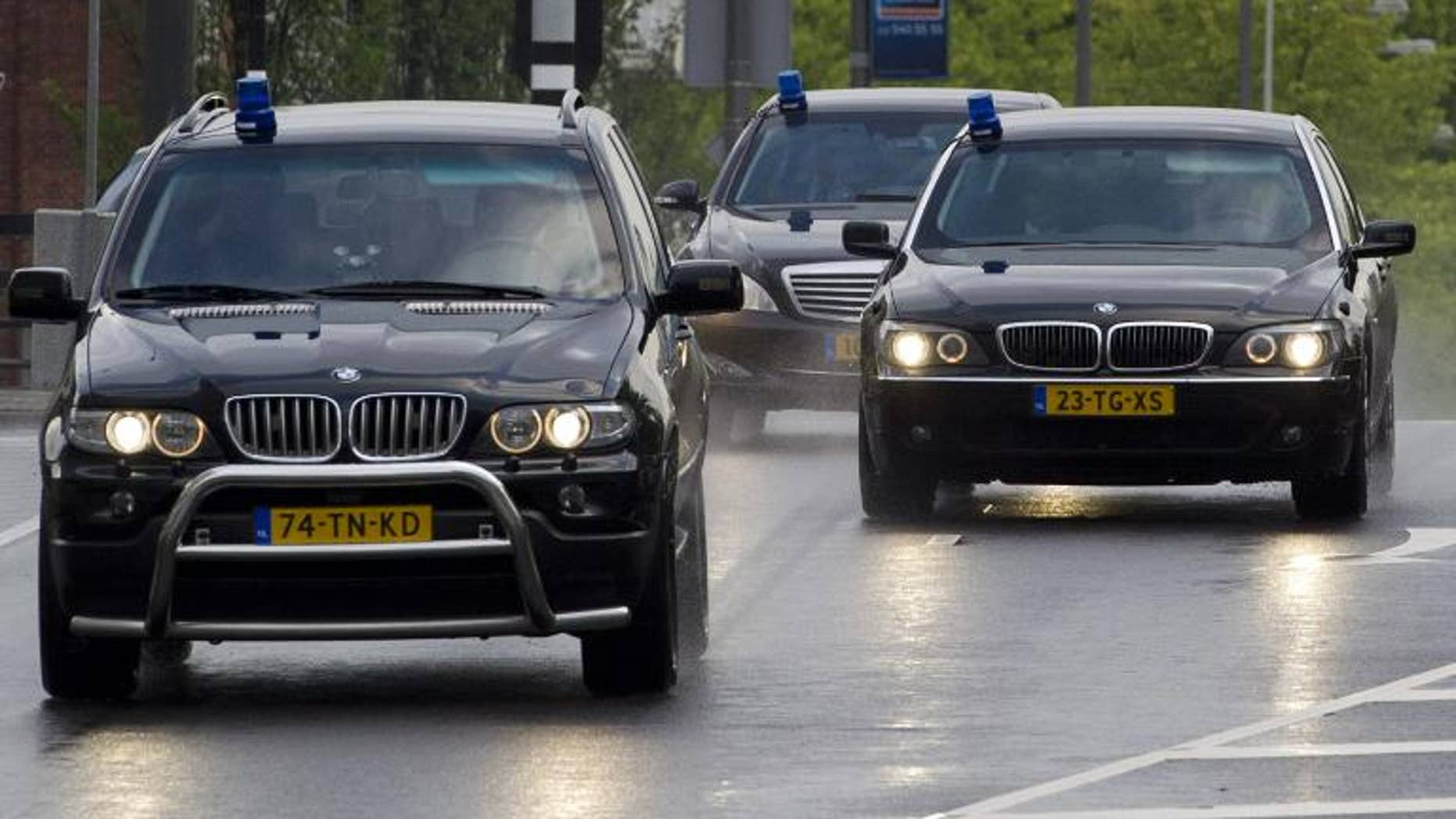 Police cars are seen in Amsterdam on June 23, 2011