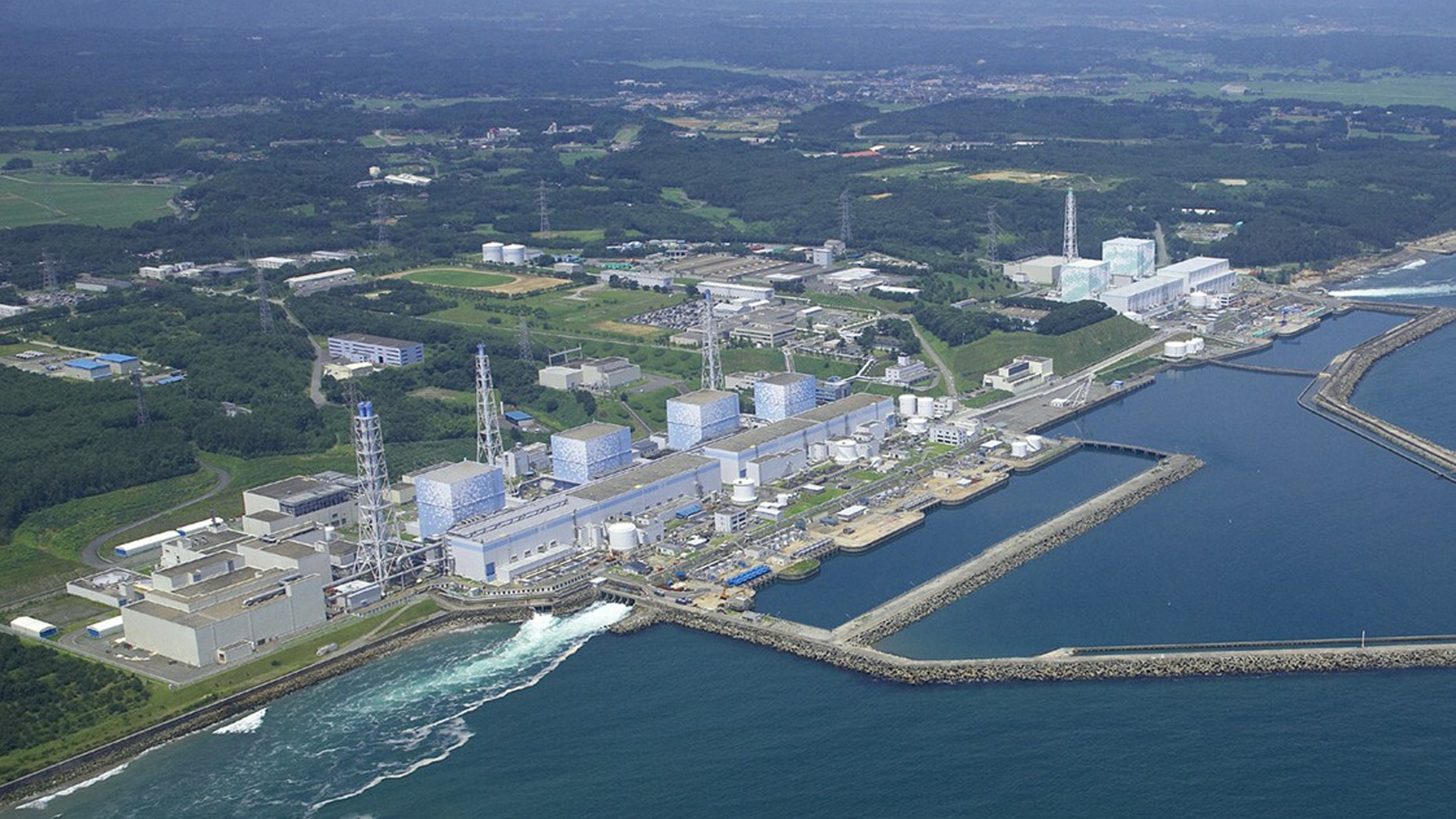 """The Fukushima Daiichi Nuclear Power Plant reactors stand in line intact in Okuma town in Fukushima Prefecture, northeastern Japan. Radiation has covered the area around the Fukushima Dai-ichi plant and blanketed parts of the complex, making the job of rendering the plant safe so that it doesn't threaten public health and the environment, or """"decommissioning"""", a bigger task than usual."""