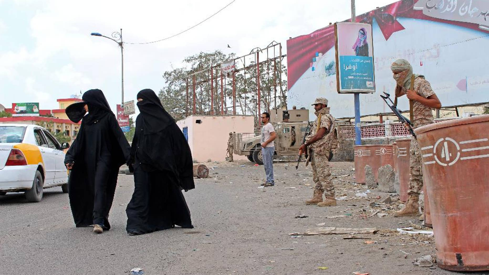 Pro-government forces stand guard on a street in the southern port city of Aden, Yemen, Wednesday, March 30, 2016. A top Yemeni security official says pro-government forces have carried out a series of raids against al-Qaida in the southern port city of Aden, arresting dozens of suspects and causing the militants to flee from key areas. (AP Photo/Wael Qubady)