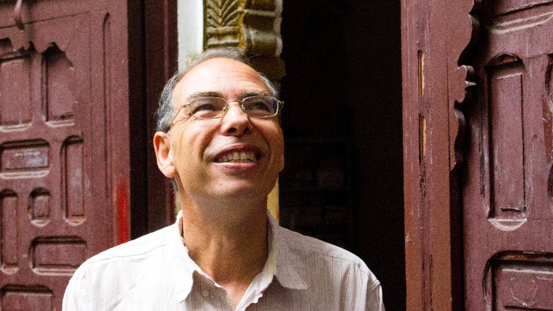 Moroccan historian and journalist Maati Monjib stands outside the local headquarters of a human rights group in Rabat, Morocco, Thursday Sept. 17, 2015. Monjib said Thursday he has gone on hunger strike after being banned from leaving the country because he is under investigation for harming the country's image. (AP Photo/Paul Schemm)