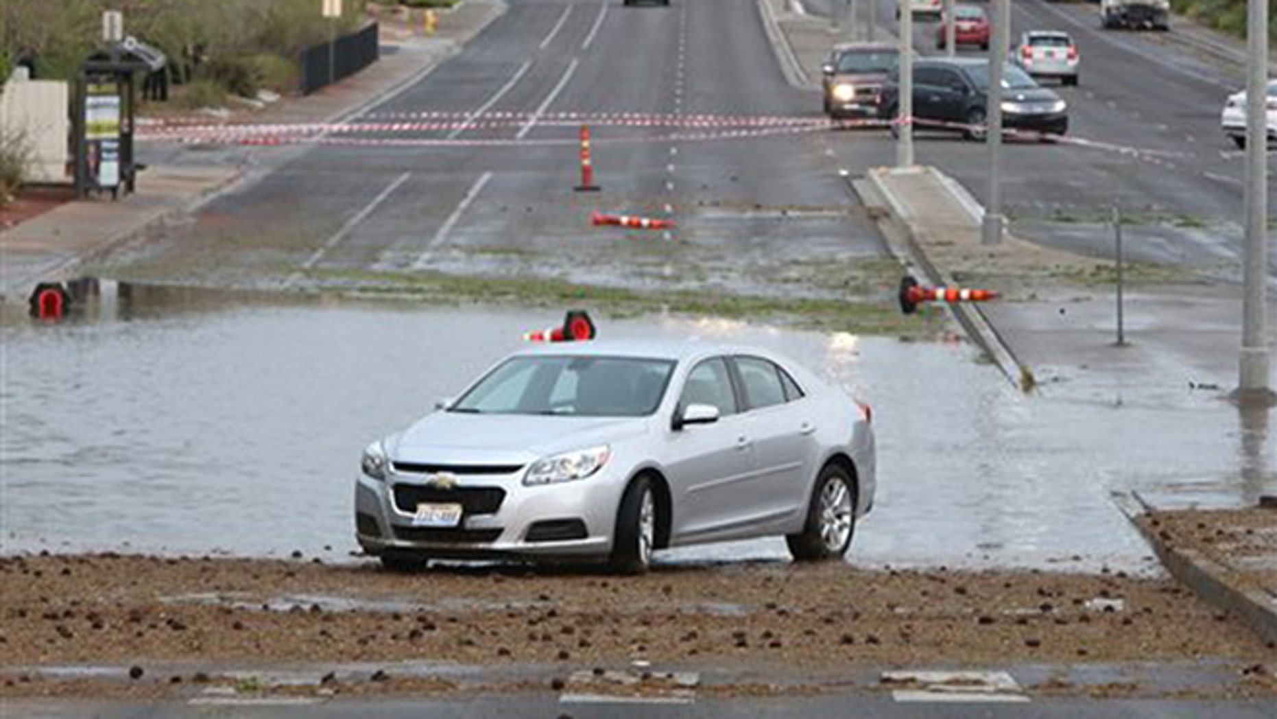 June 30, 2016: A disabled vehicle sits on Pecos Road near Robindale Road and Windmill Parkway due to flooding as late afternoon storms move through Las Vegas Valley in Las Vegas.
