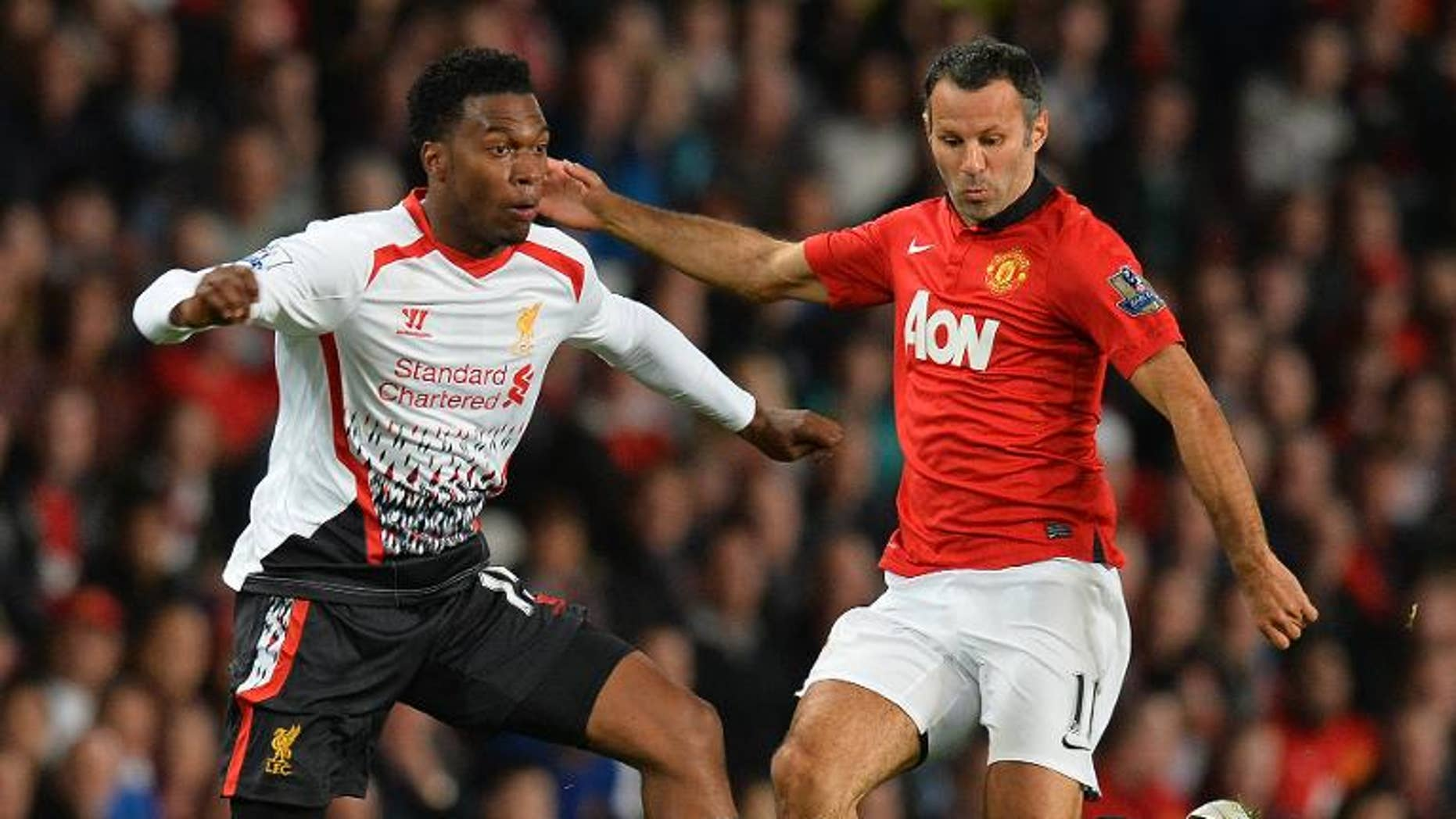 Manchester United's Ryan Giggs (right) vies with Liverpool's Daniel Sturridge at Old Trafford in Manchester on September 25, 2013