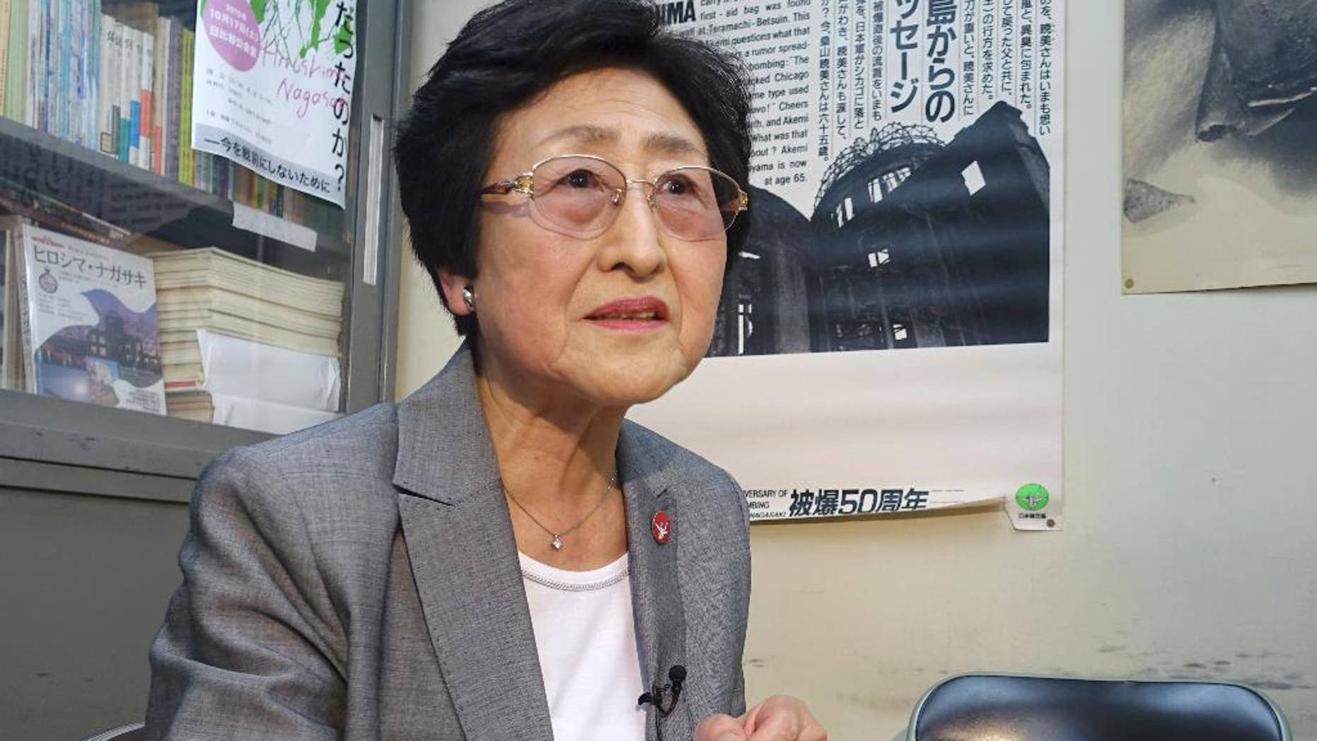 "In this Thursday, May 12, 2016 photo, Michiko Kodama, 78, a survivor of the Hiroshima atomic bombing, speaks during an interview at an office of a survivors' organization in Tokyo. A flash in the sky over Hiroshima, Japan, in 1945 caused a lifetime of ordeal for an elementary school student Michiko Kodama. For her World War II will not be over until a nuclear-free world is achieved and President Barack Obama's visit to Hiroshima on Friday is ""just a step in the process."" (AP Photo/Mari Yamaguchi)"