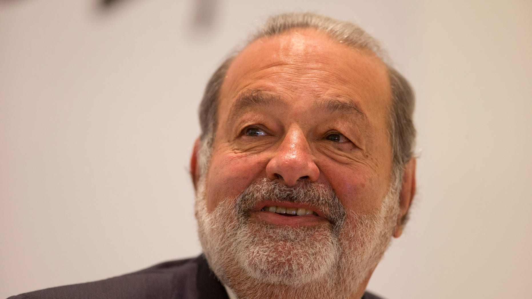 FILE - In this Jan. 14, 2013 file photo, Mexican telecommunications tycoon Carlos Slim speaks during news conference at the Soumaya museum in Mexico City. Slim recently bought part of two of Mexico's first division soccer teams, setting up another showdown with television giants Televisa and TV Azteca, major players in the soccer field that are in turn trying to push their way into Slim's telecommunications and Internet markets. (AP Photo/Dario Lopez-Mills, File)