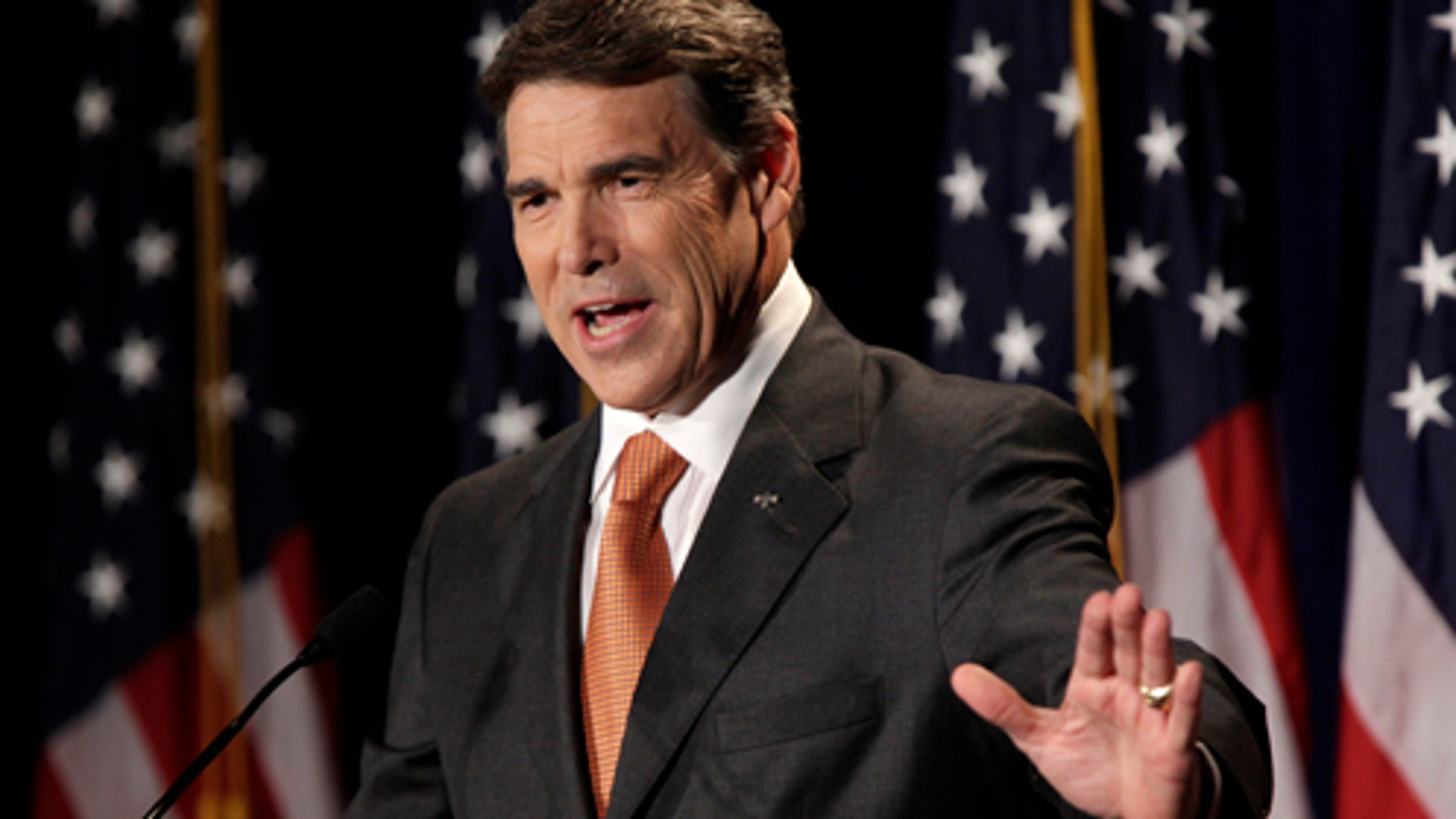 AUG. 13:  Texas Gov. Rick Perry speaks during his announcement that he will run for the Republican presidential nomination in Charleston, South Carolina. (Photo by Richard Ellis/Getty Images)