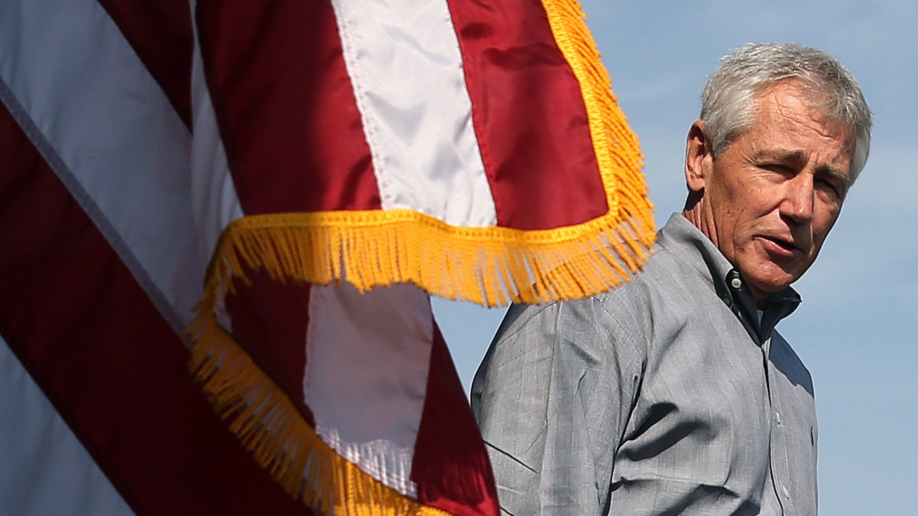 """U.S. Defense Secretary Chuck Hagel speaks to military service members aboard the USS Ponce in Manama, Bahrain, Friday, Dec. 6, 2013. Standing on the massive deck of the Navy's USS Ponce, Hagel said the U.S. is entering the new nuclear pact with Iran """"very clear eyed"""" and it remains to be see whether Tehran is serious about keeping its development peaceful. (AP Photo/Mark Wilson, Pool)"""