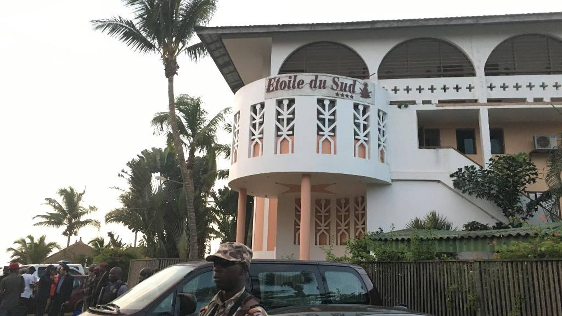 A soldier stands outside the Etoile du Sud, where gunmen attacked earlier in March.