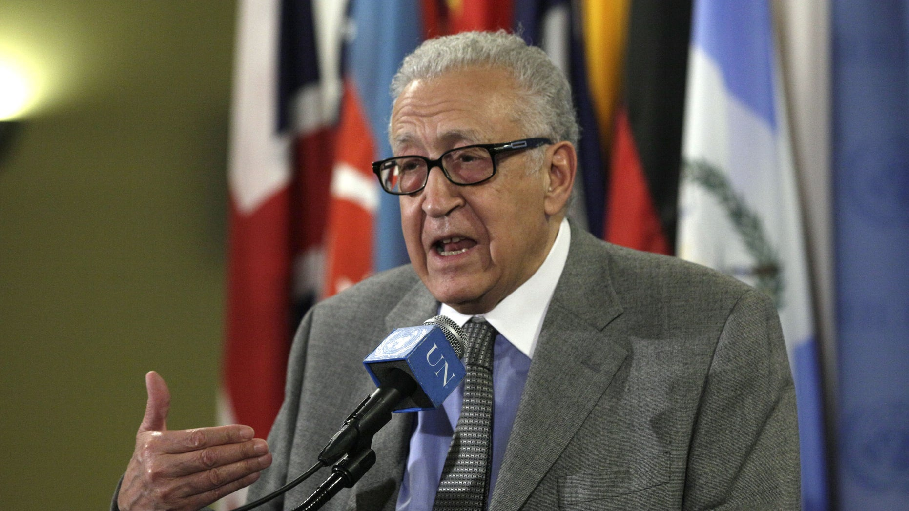 FILE - In this Nov. 29, 2012 file photo, Lakhdar Brahimi, Joint Special Representative of the United Nations and the League of Arab States for Syria, answers media questions after consultations at United Nations headquarters. A government airstrike on a bakery in a rebel-held town in central Syria killed more than 60 people, activists said, casting a pall over a visit by Brahimi, the international envoy charged with negotiating an end to the country's civil war. (AP Photo/Richard Drew, File)