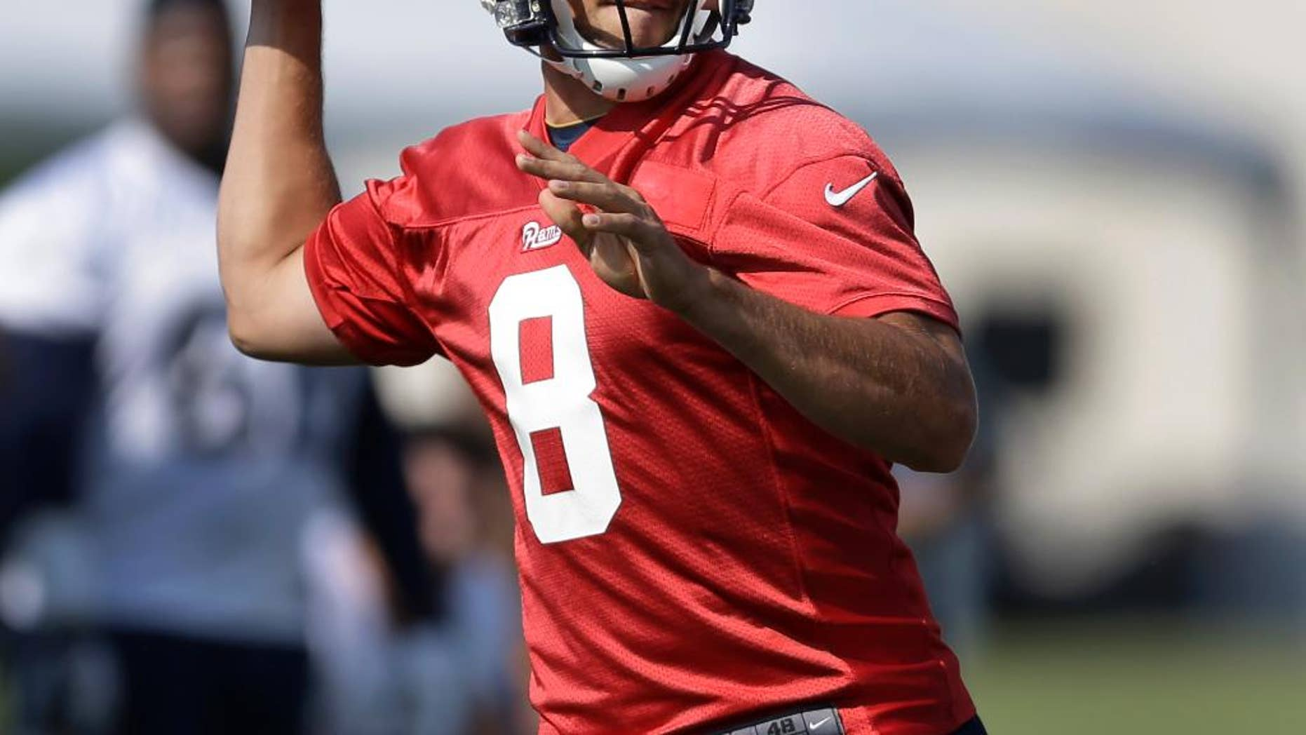 St. Louis Rams quarterback Sam Bradford throws during training camp at the NFL football team's practice facility on Friday, July 25, 2014, in St. Louis. (AP Photo/Jeff Roberson)
