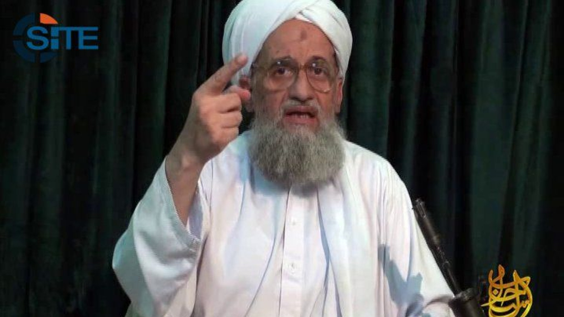 FILE -- In this undated file frame grab from video provided by IntelCenter, an American private terrorist threat analysis company, shows Al-Qaida's leader Ayman Al-Zawahri in a still image from a web posting by al-Qaida's media arm, as-Sahab, Wednesday July 27, 2011. Al-Qaida's leader has urged Muslims in Arab Spring countries to unite to institute an Islamic state, while warning France that its intervention in Mali will be bogged down, in a 103-minute audio message posted on militant websites late Saturday, April 6, 2013. In the recording, al-Zawahri urged Muslims to liberate their lands, apply Islamic law, halt the plundering of Muslim wealth, support rebellious Muslims and oppressed people worldwide, and establish the Islamic Caliphate, or religious state. (AP Photo/IntelCenter, File)  THE ASSOCIATED PRESS HAS NO WAY OF INDEPENDENTLY VERIFYING THE CONTENT, LOCATION OR DATE OF THIS PICTURE. NO SALES MANDATORY CREDIT, INTELCENTER