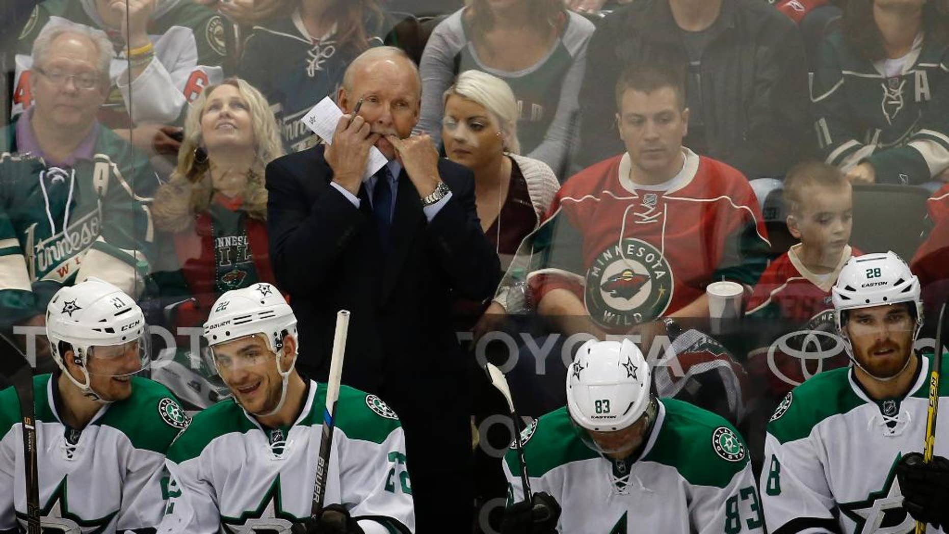 Dallas Stars head coach Lindy Ruff, top, whistles to his players during the second period of Game 6 in the first round of the NHL Stanley Cup playoffs against the Minnesota Wild in St. Paul, Minn., Sunday, April 24, 2016. The Stars won 5-4 to advance to the second round. (AP Photo/Ann Heisenfelt)